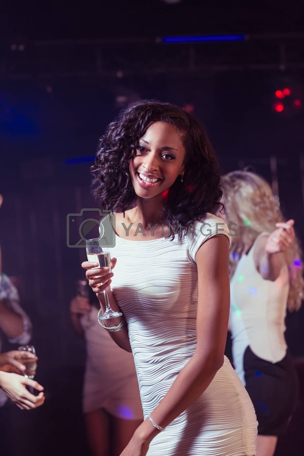 Happy woman dancing in a club