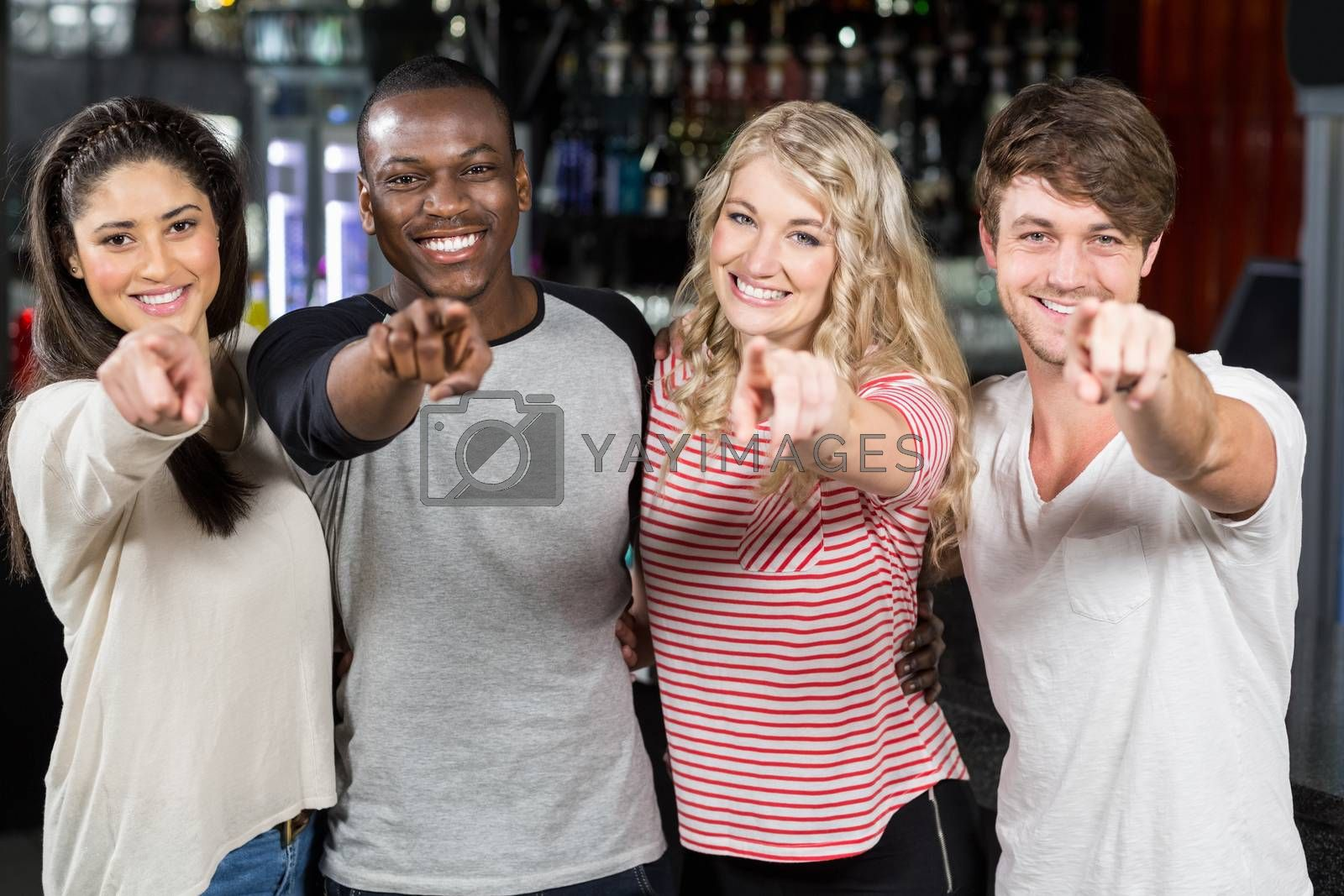 Friends pointing with finger in a bar