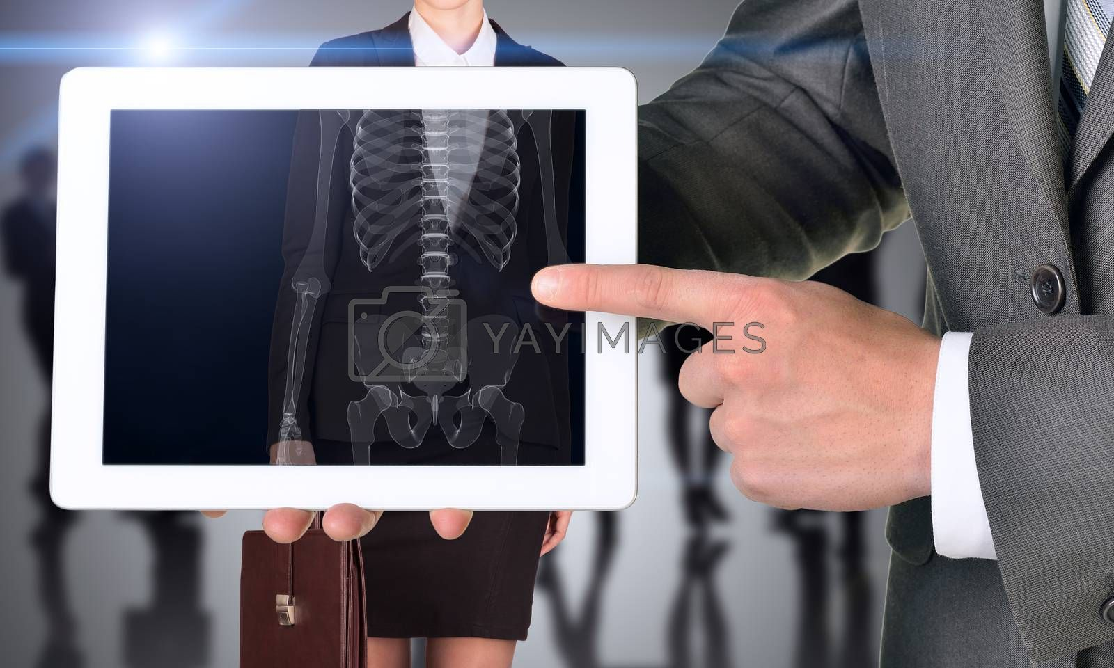 Businessman with tablet and xray human body