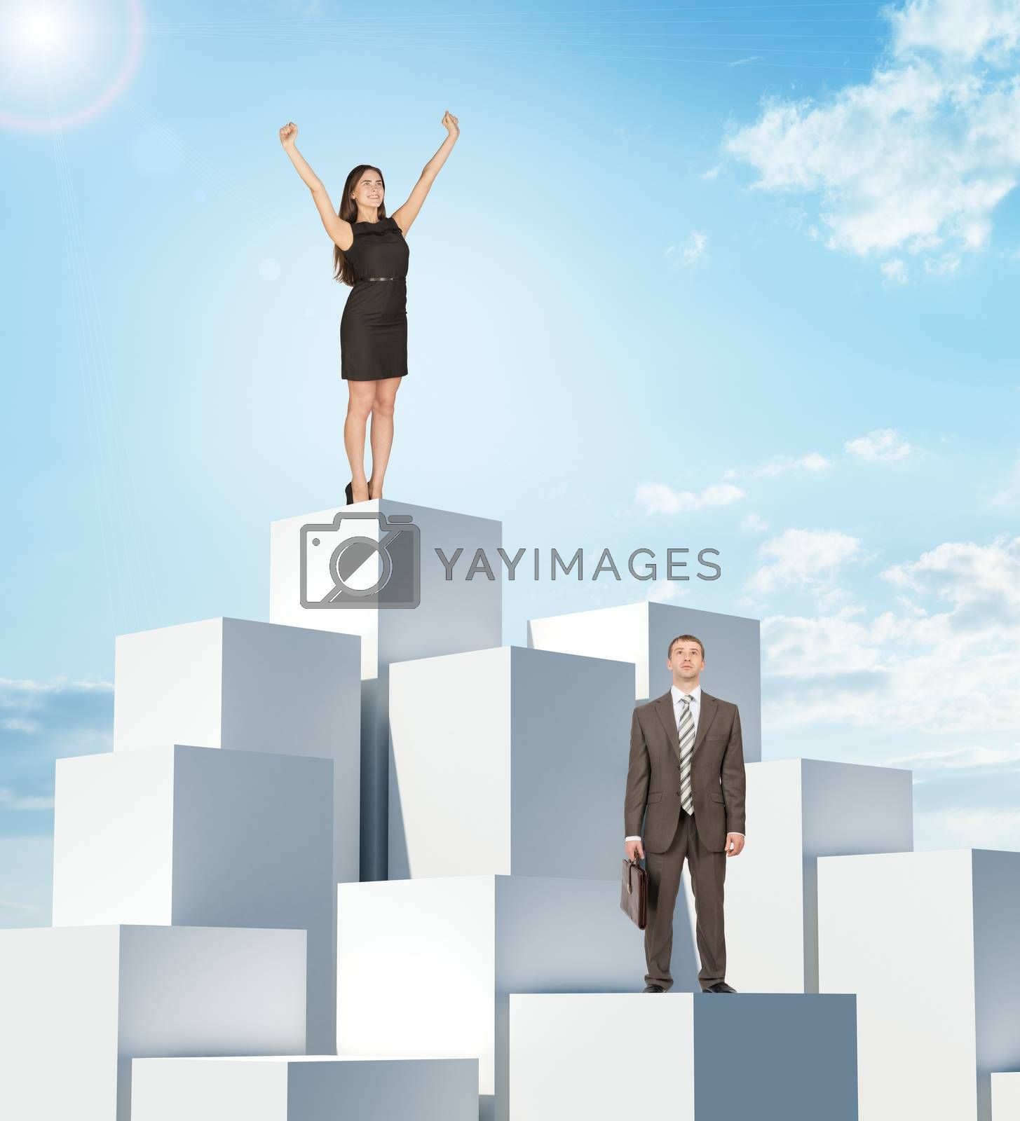 Businesspeople on boxes pile on blue sky background