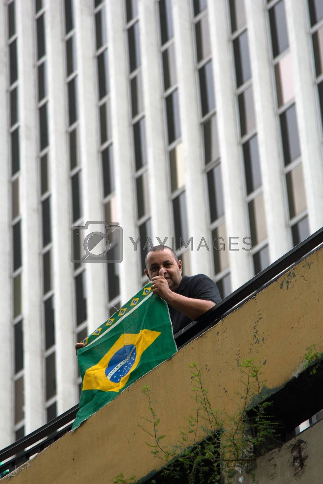 Paulo Brazil March 13, 2016: One unidentified man with brazilian flag in the biggest protest against federal government corruption in Sao Paulo.
