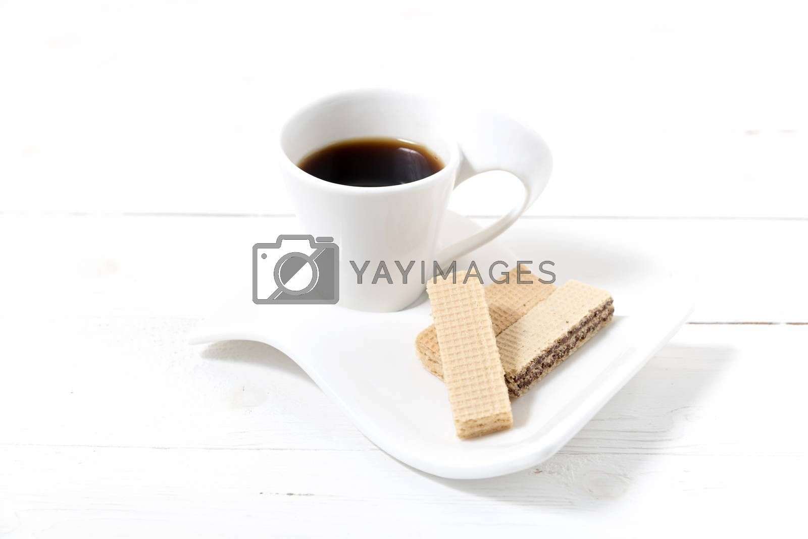 coffee cup with wafer on white wood background