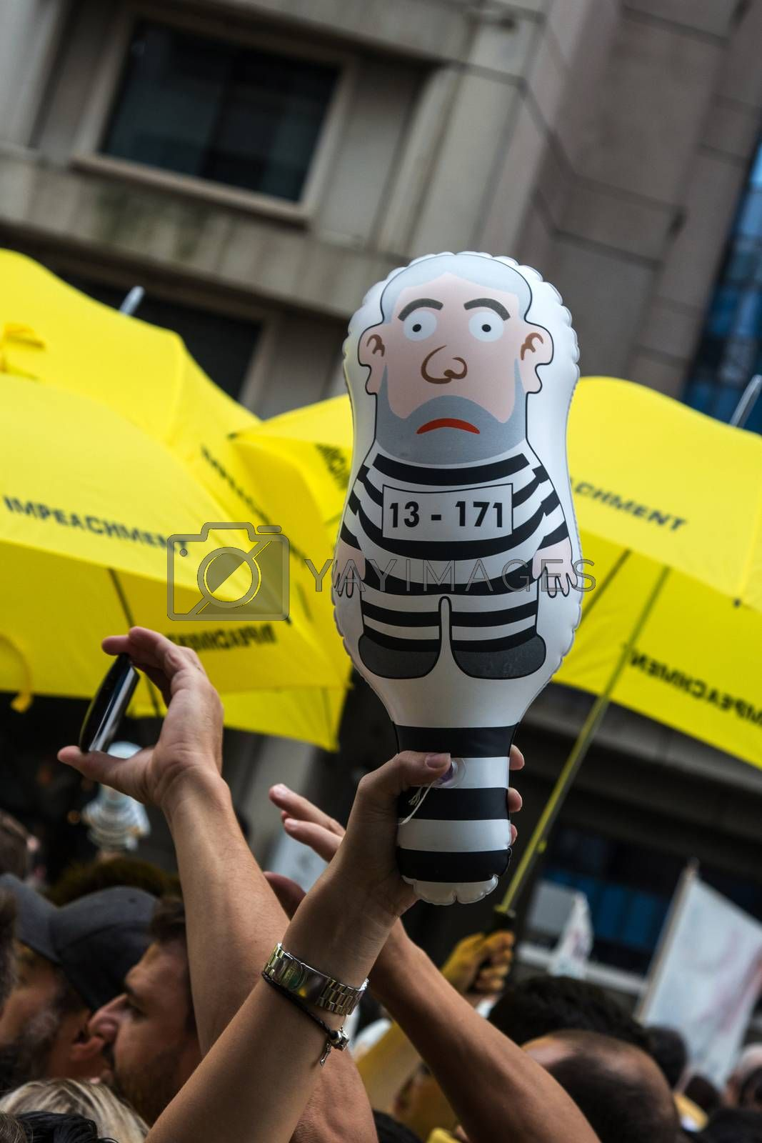 Sao Paulo Brazil March 13, 2016: One unidentified group of people in the biggest protest against federal government corruption in Sao Paulo with an inflated doll called pixuleco.
