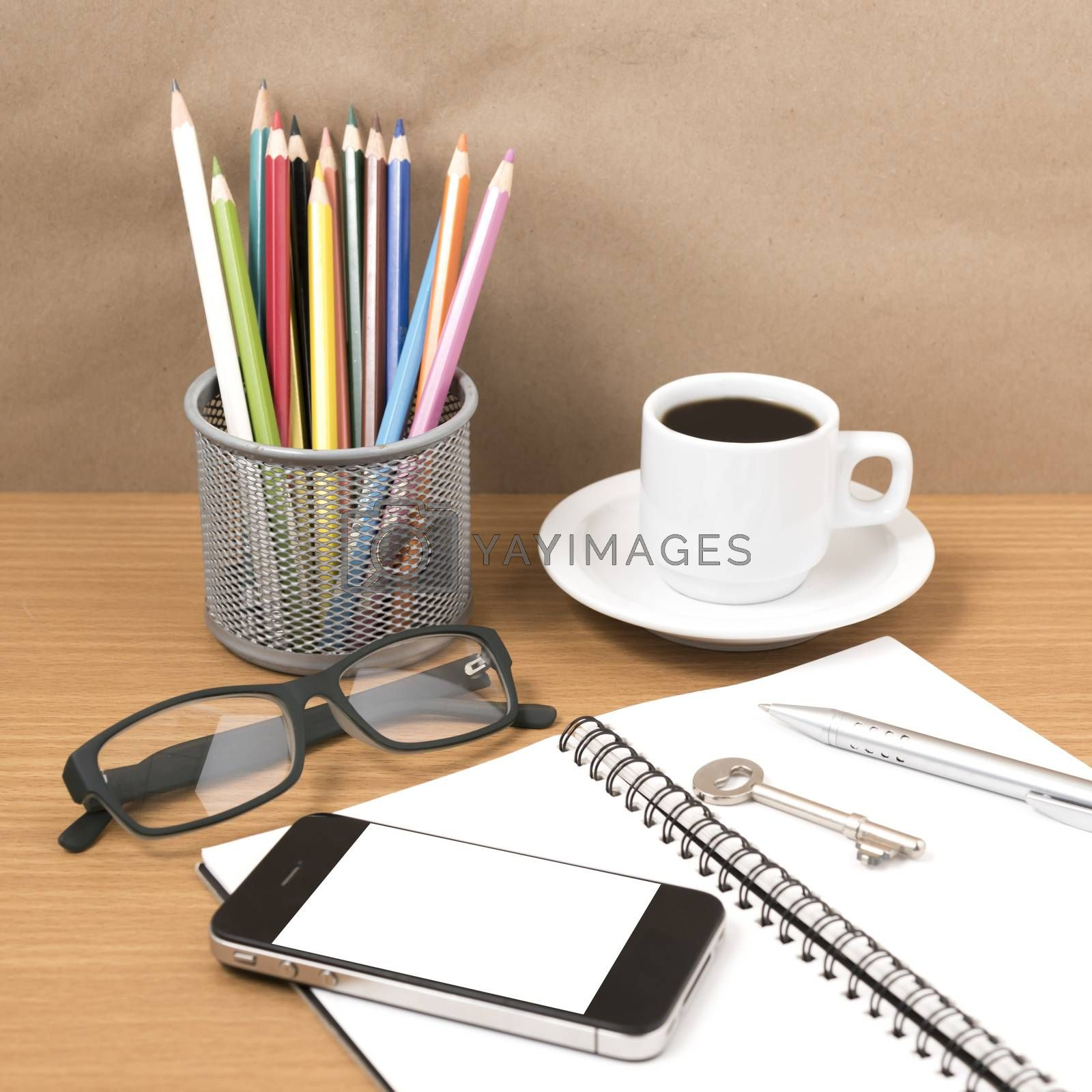 office desk : coffee and phone with key,eyeglasses,notepad,pencil box