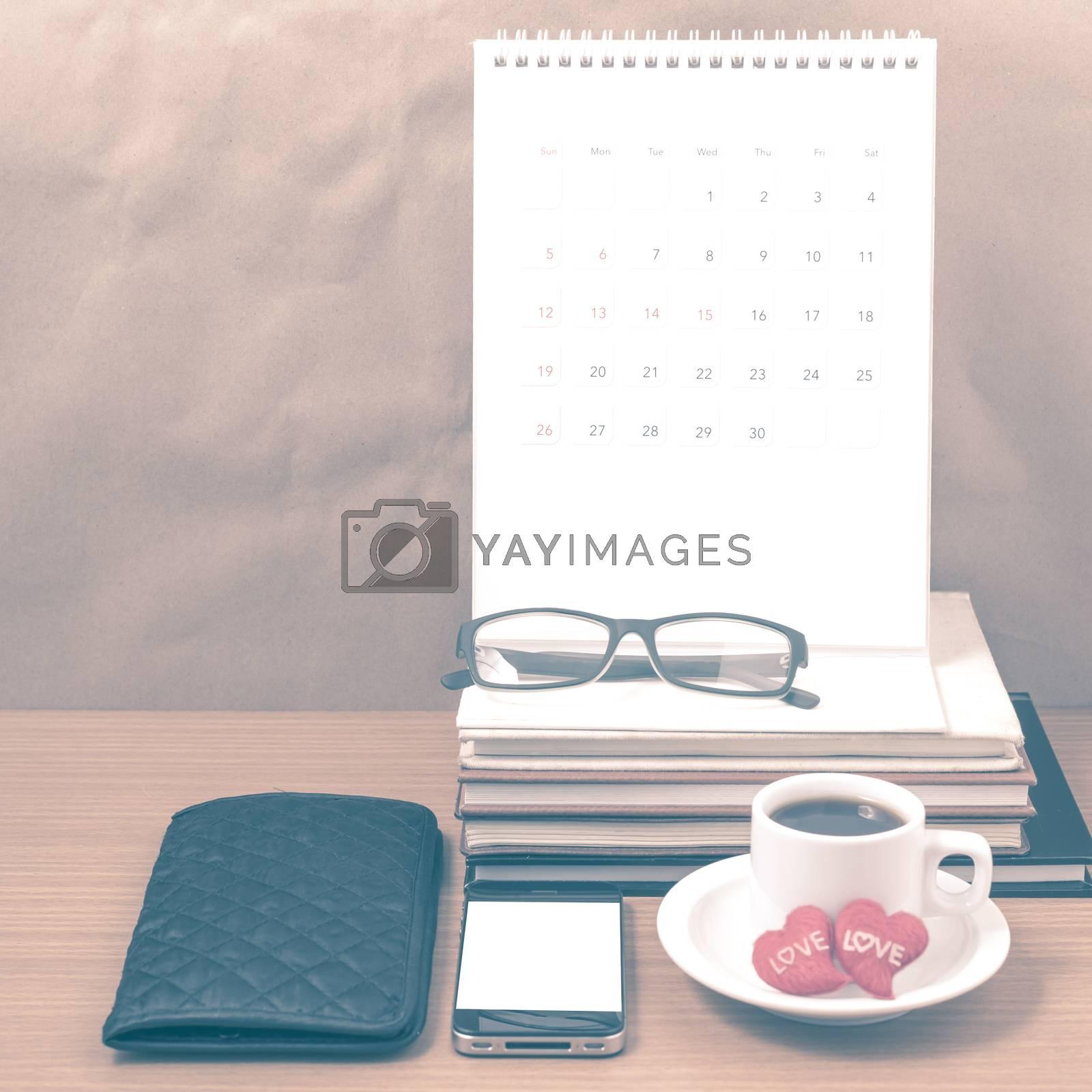 office desk : coffee with phone,wallet,calendar,heart,stack of b by Nisakorn Neera