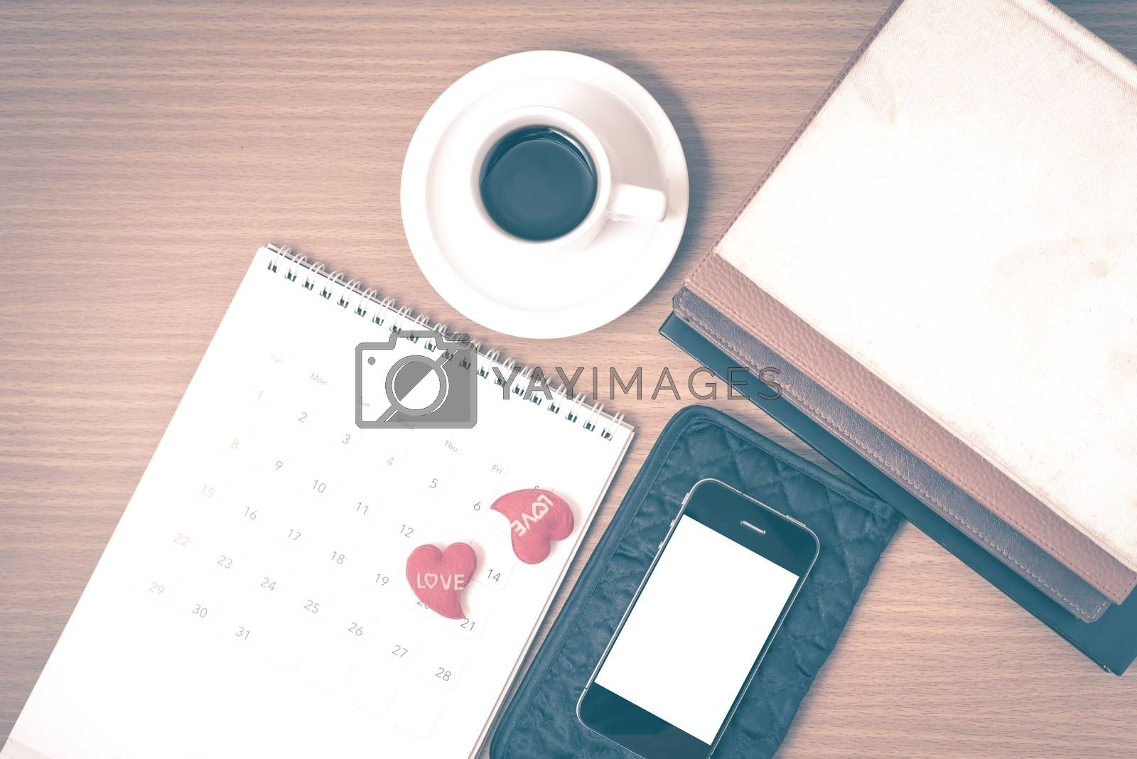 office desk : coffee with phone,wallet,calendar,heart,stack of b by Nisakorn Neera