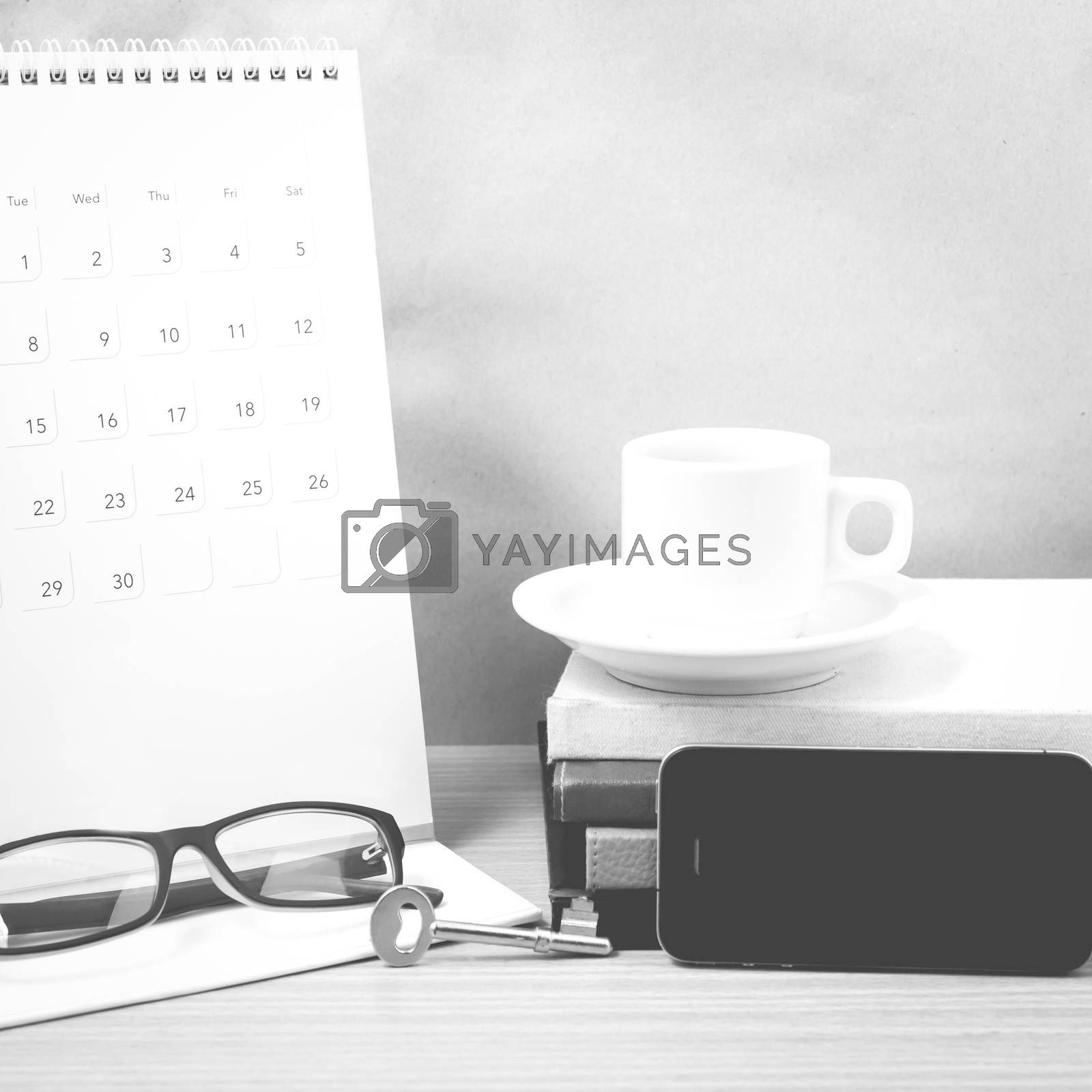 coffee and phone with key,eyeglasses,stack of book,calendar blac by Nisakorn Neera