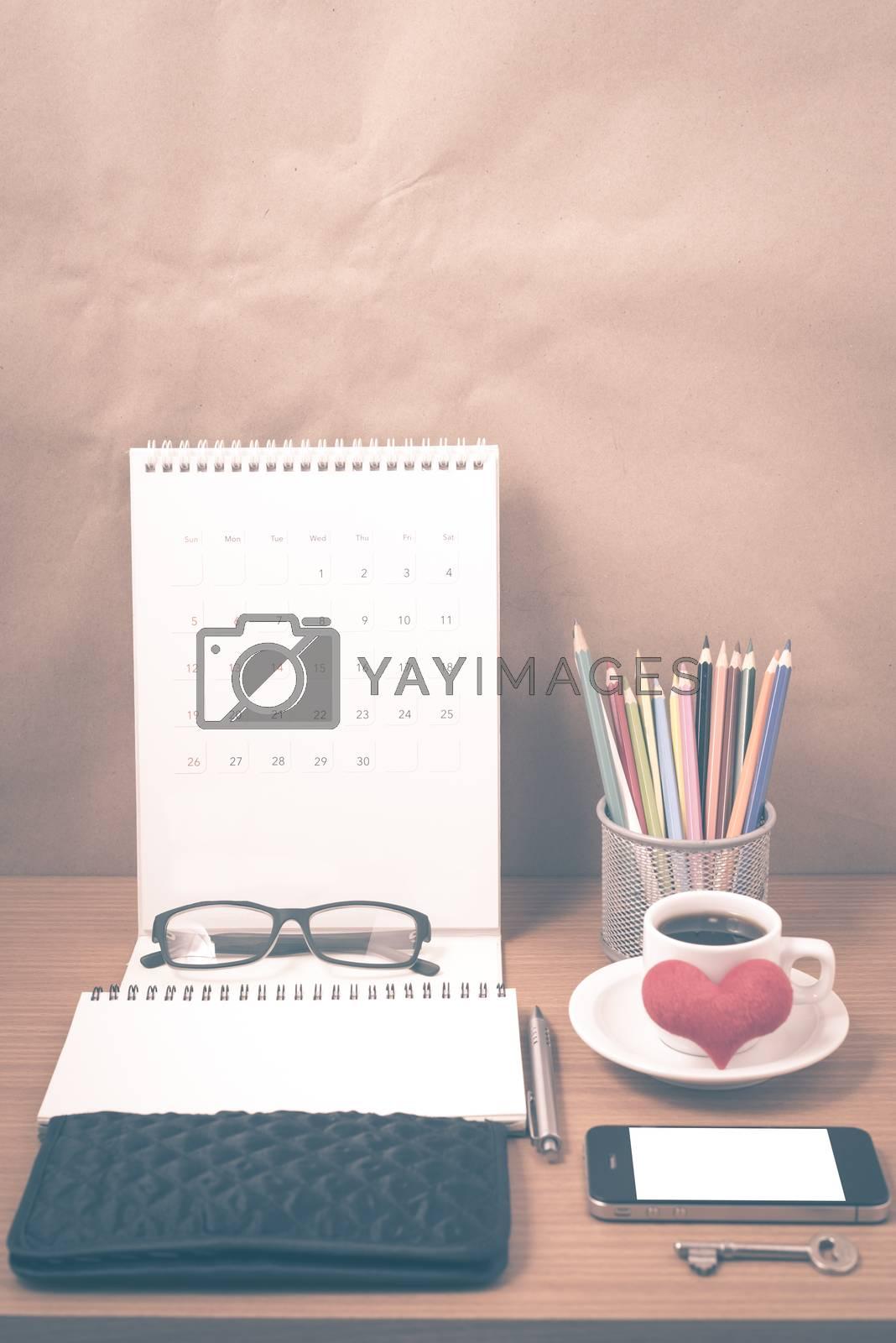 office desk : coffee with phone,wallet,calendar,heart,notepad,ey by Nisakorn Neera