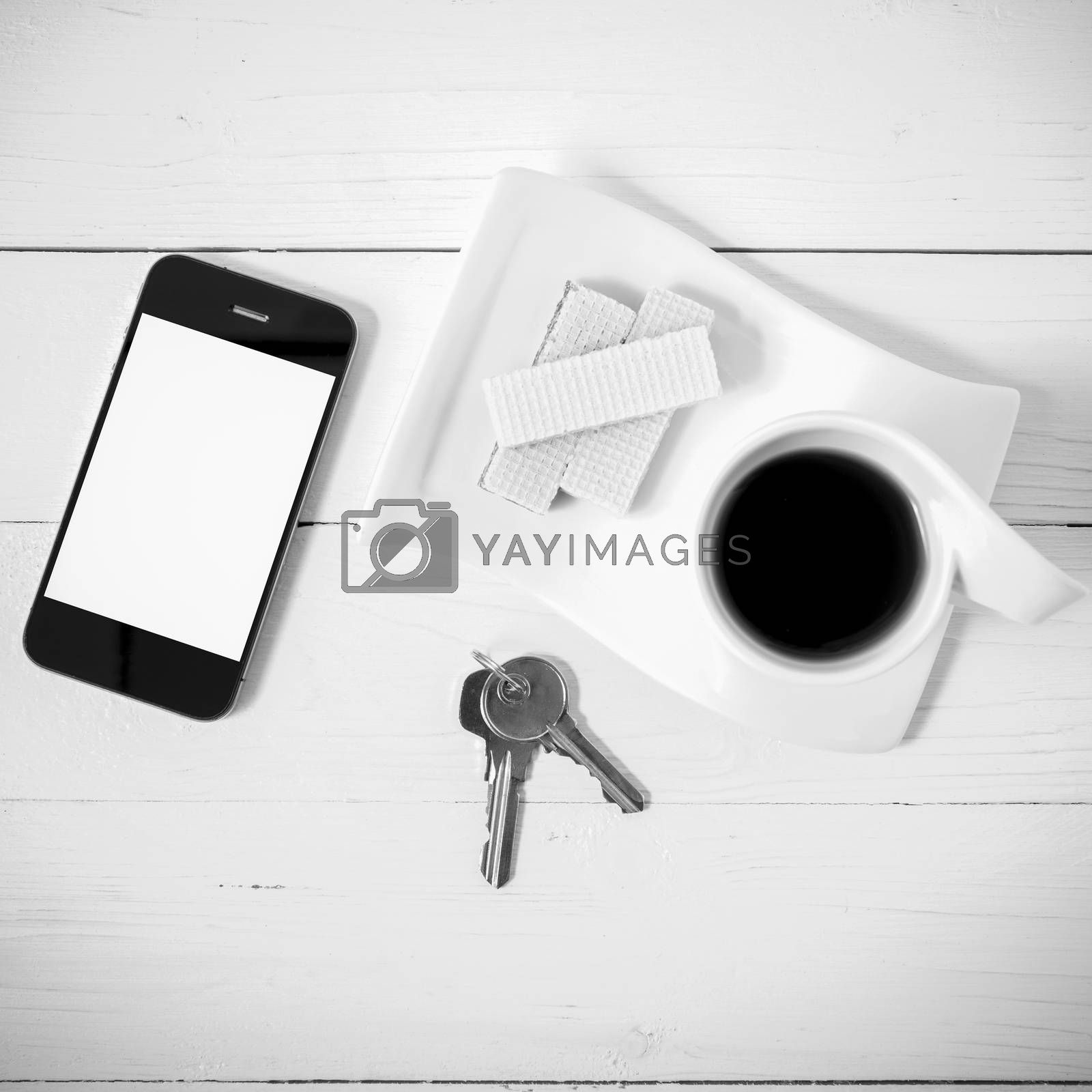 coffee cup with wafer,phone,key black and white color by Nisakorn Neera