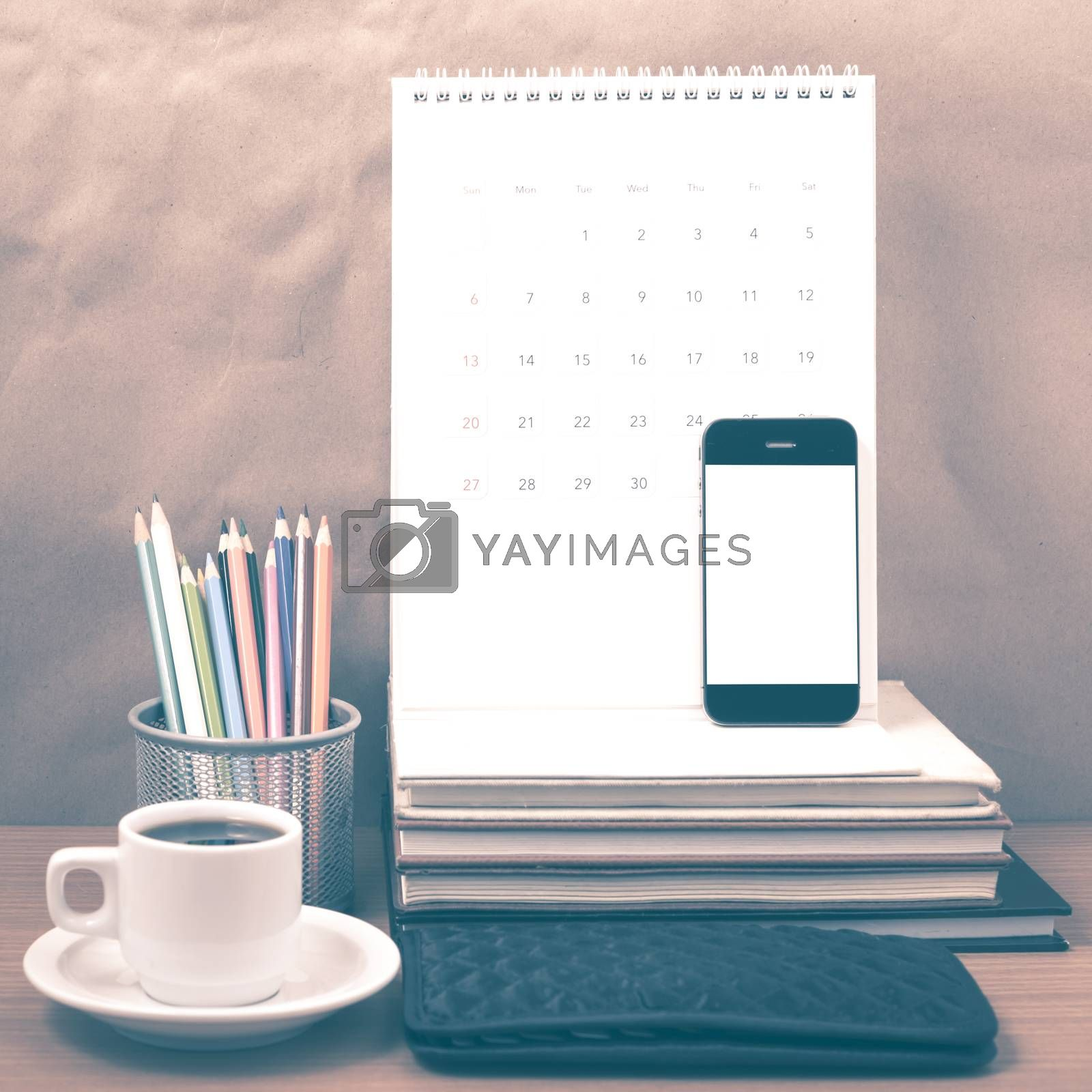 office desk : coffee with phone,wallet,calendar,color pencil box by Nisakorn Neera