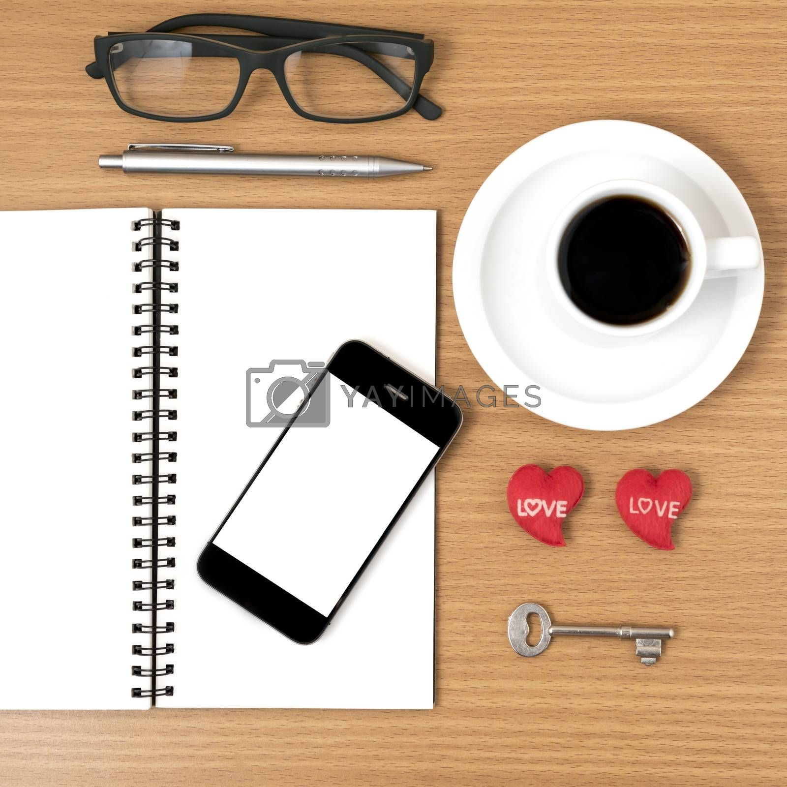 office desk : coffee and phone with key,eyeglasses,notepad,heart on wood background