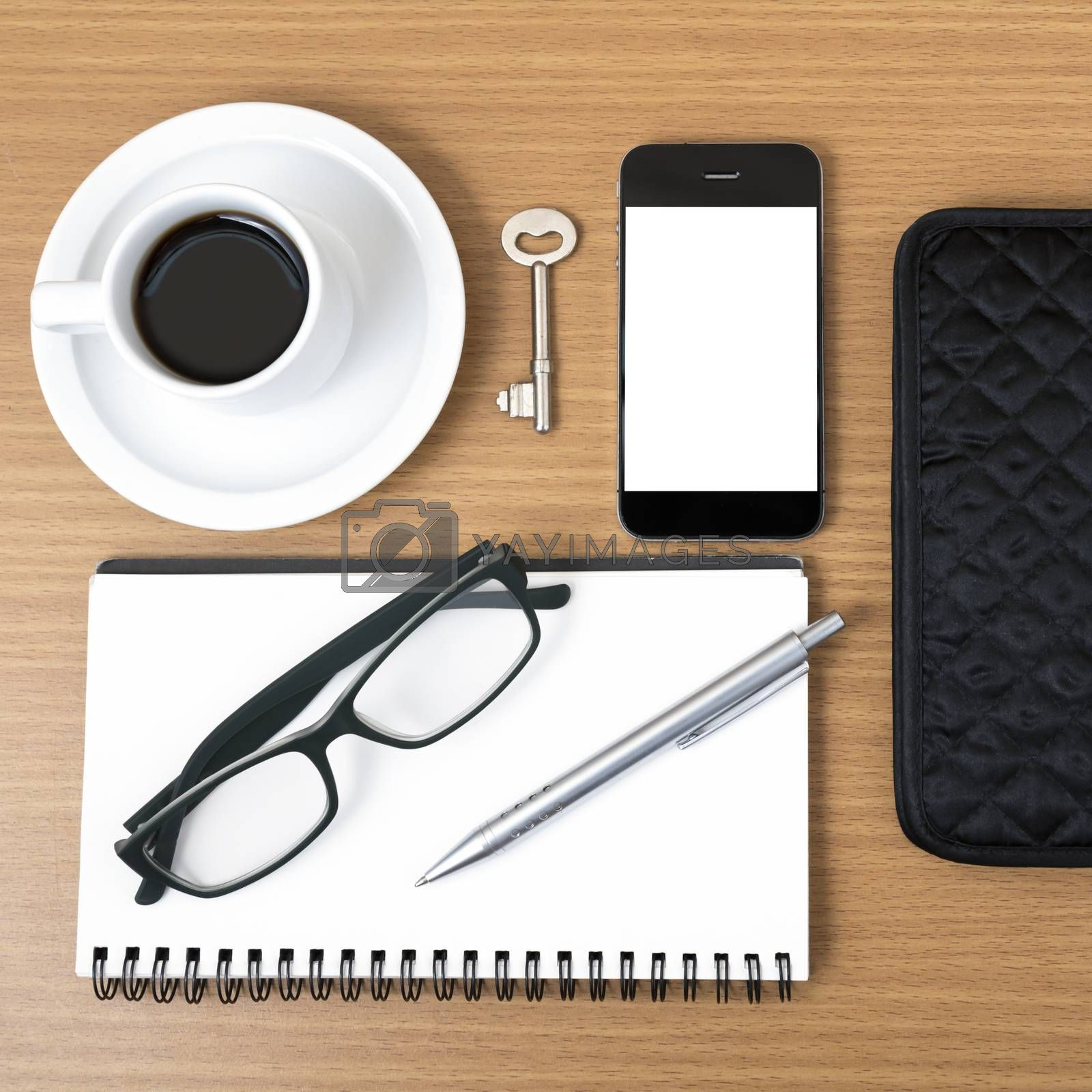 coffee and phone with notepad,key,eyeglasses and wallet by Nisakorn Neera