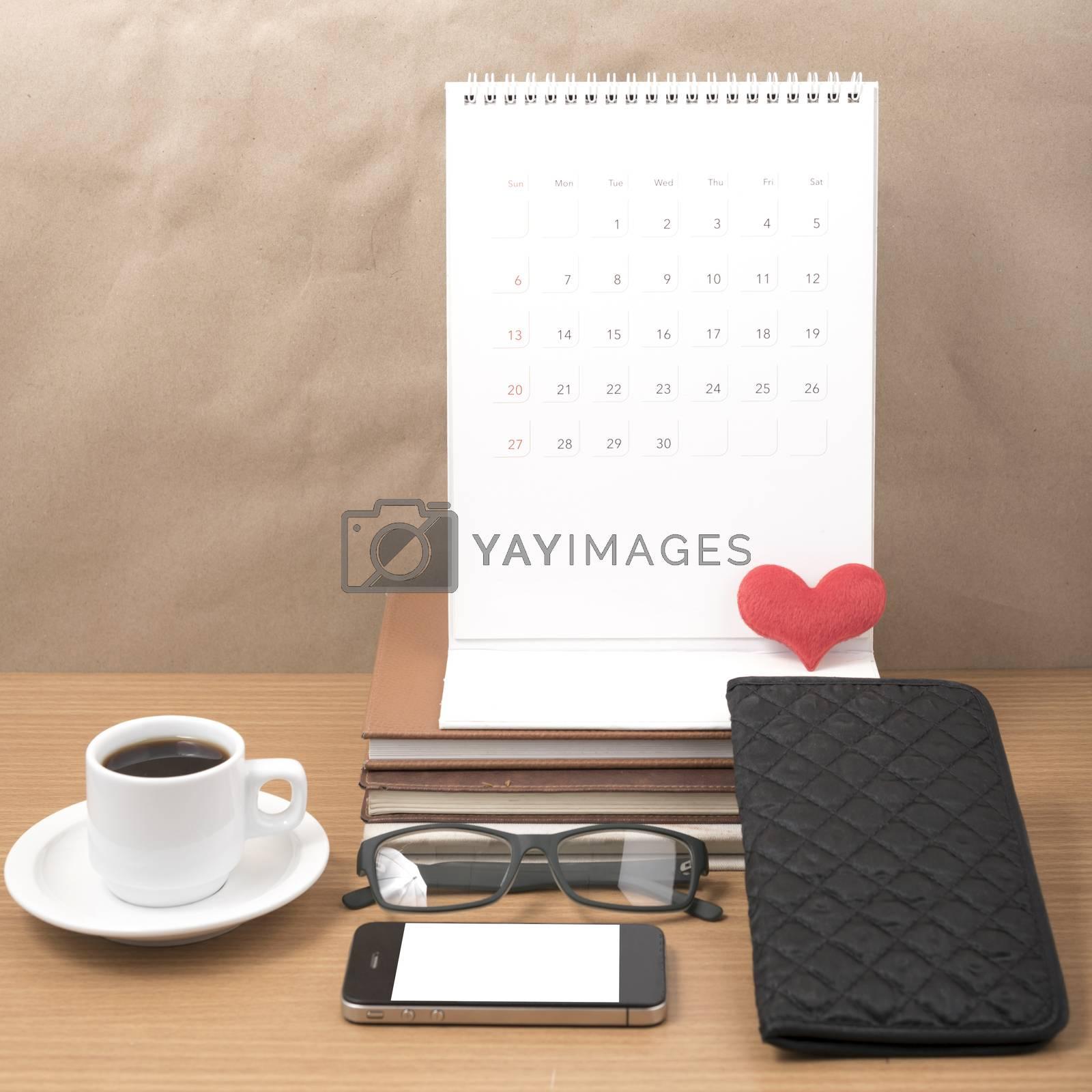office desk : coffee with phone,stack of book,eyeglasses,wallet, by Nisakorn Neera