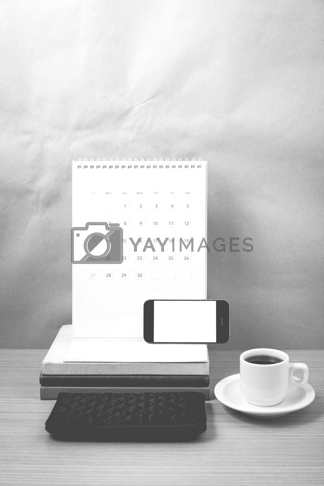 working table : coffee with phone,stack of book and wallet black by Nisakorn Neera