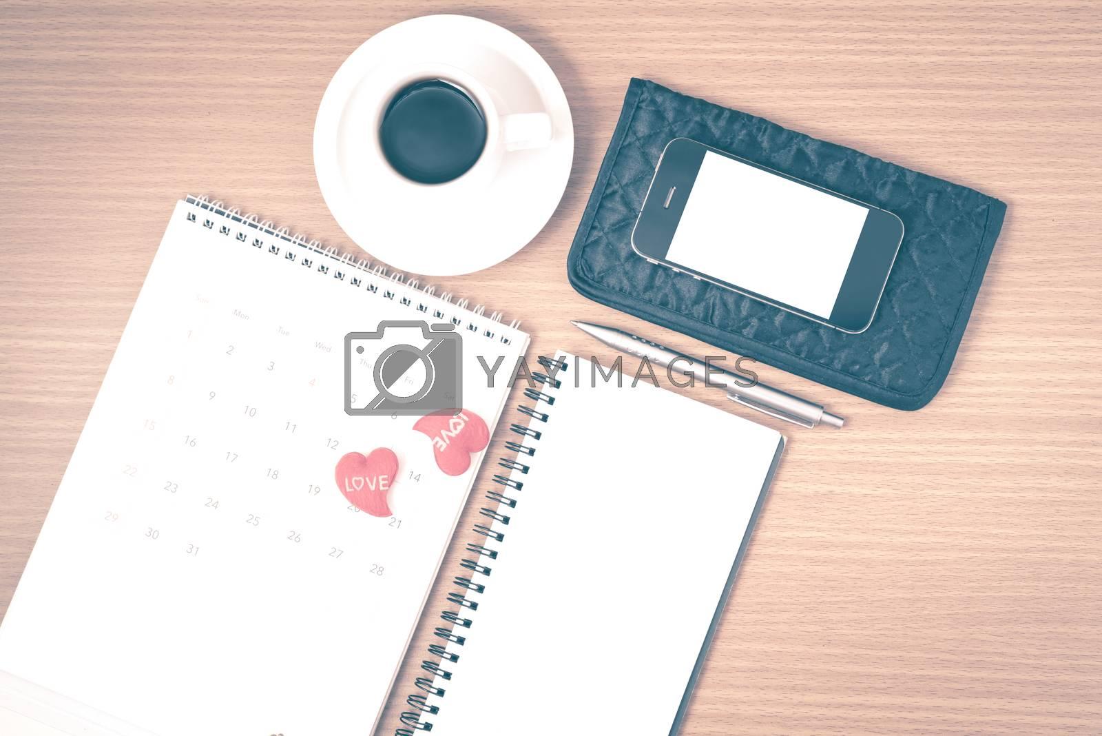 office desk : coffee with phone,wallet,calendar,heart,notepad vi by Nisakorn Neera