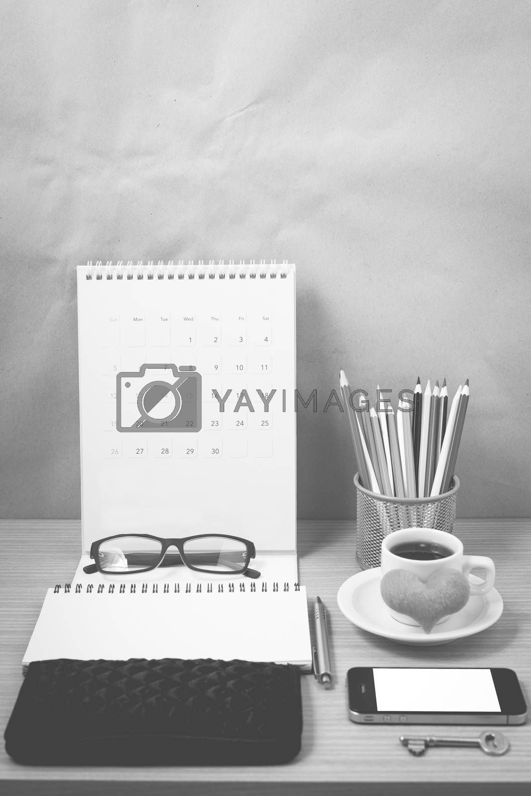 office desk : coffee with phone,wallet,calendar,heart,notepad,eyeglasses,color pencil box,key on wood background black and white color