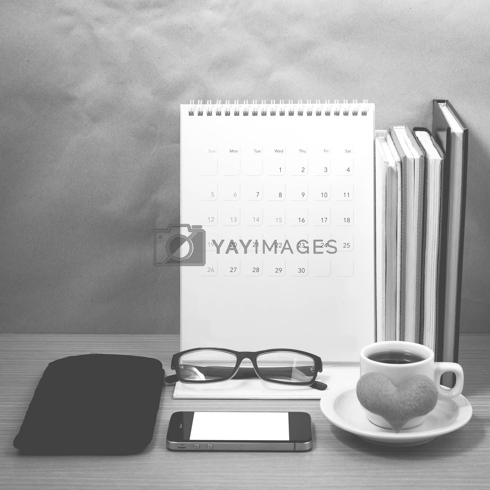 desktop : coffee with phone,stack of book,wallet,heart,eyeglasse by Nisakorn Neera