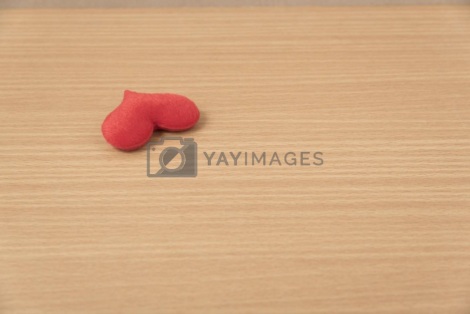 red heart on wood by Nisakorn Neera
