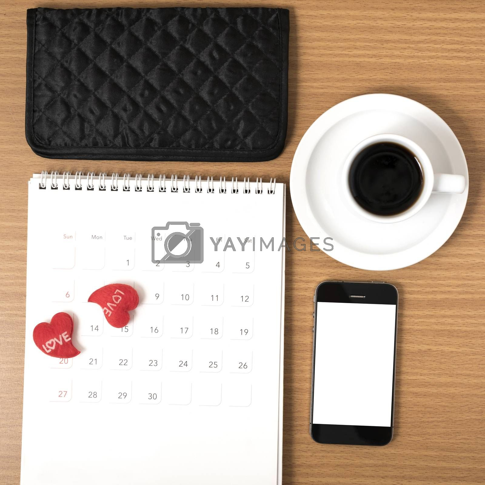 office desk : coffee with phone,calendar,wallet,heart on wood background