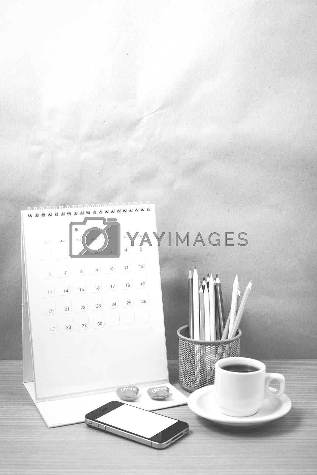 office desk : coffee with phone,calendar,heart,color pencil on wood background black and white color