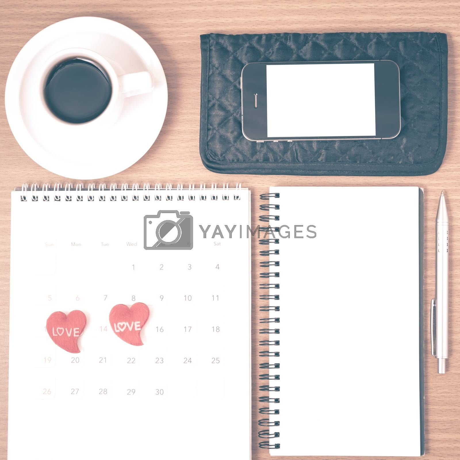 office desk : coffee with phone,wallet,calendar,heart,notepad on wood background vintage style