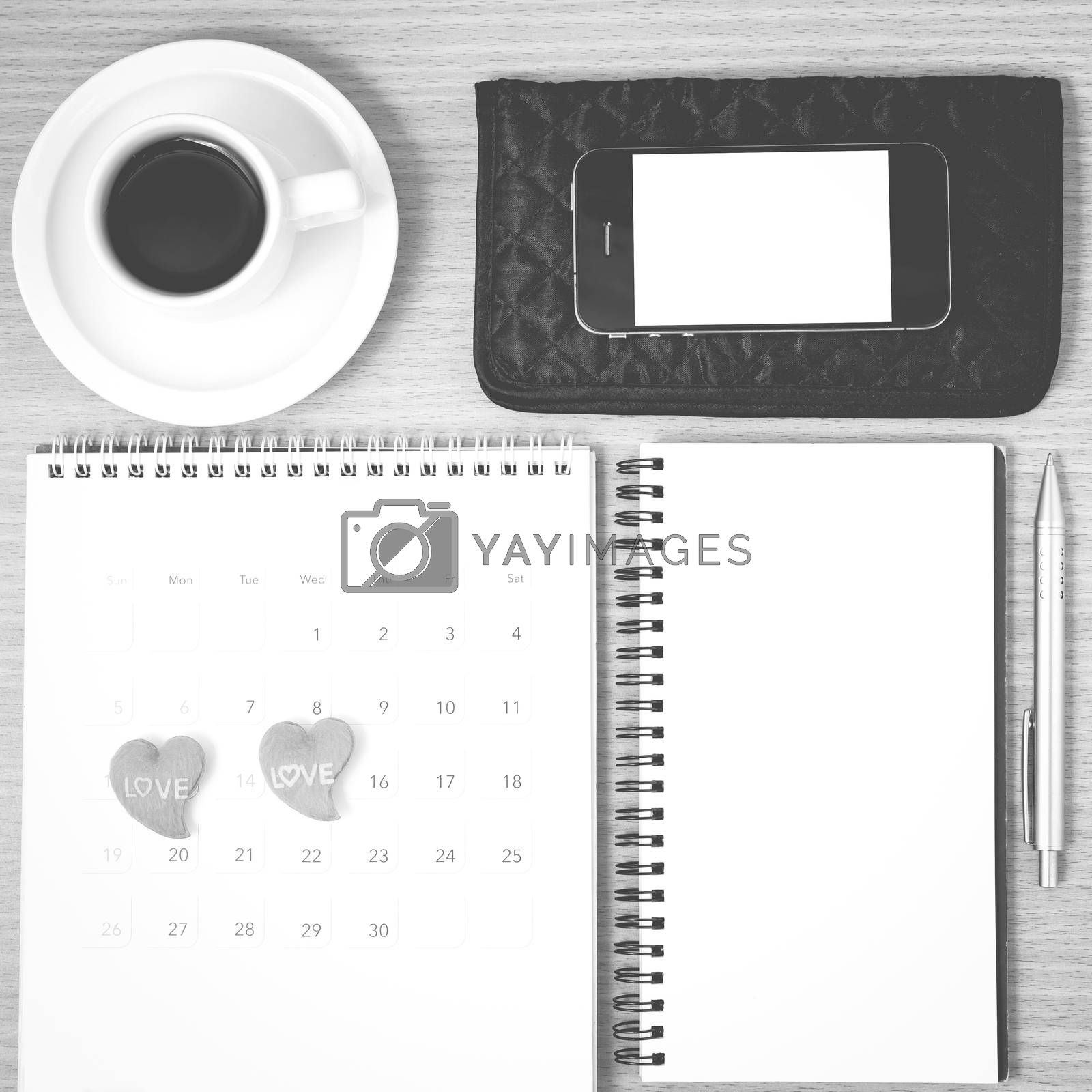 office desk : coffee with phone,wallet,calendar,heart,notepad on wood background black and white color