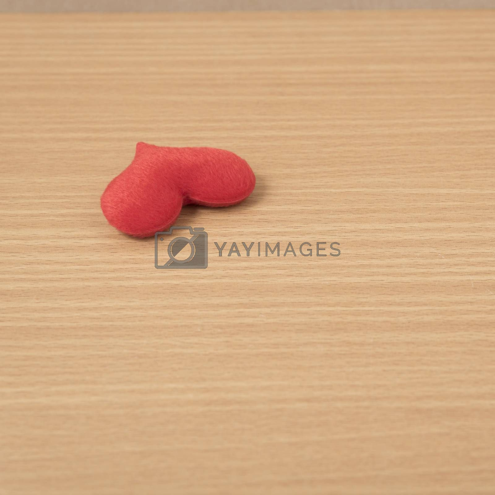 red heart on wood table background
