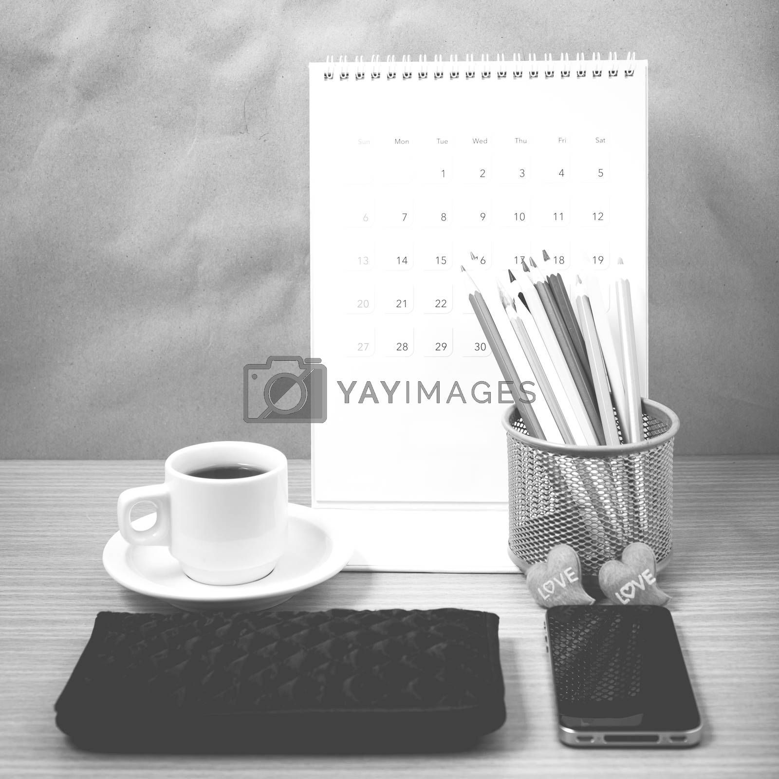 office desk : coffee with phone,wallet,calendar,heart,color pencil box on wood background black and white color