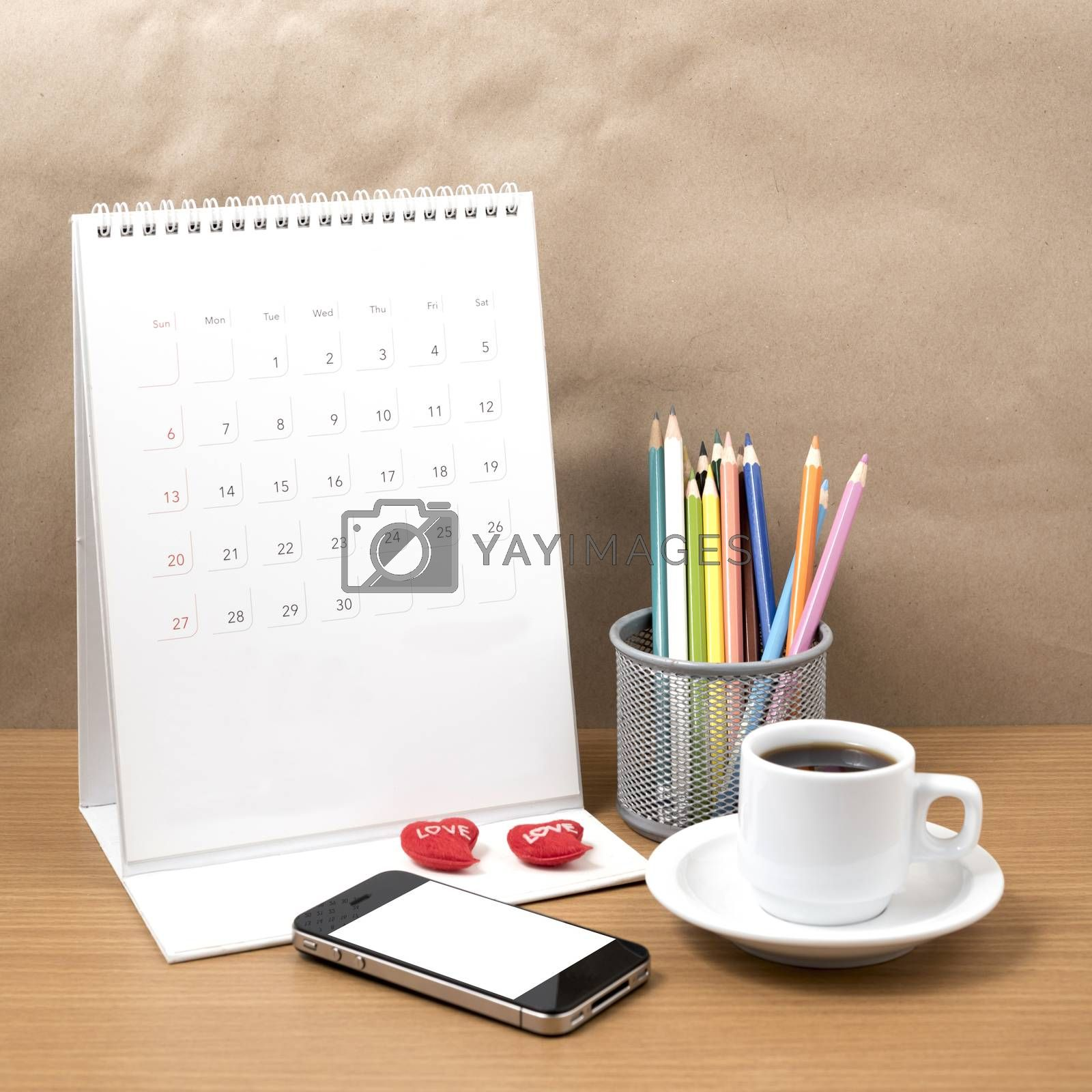 office desk : coffee with phone,calendar,heart,color pencil on wood background