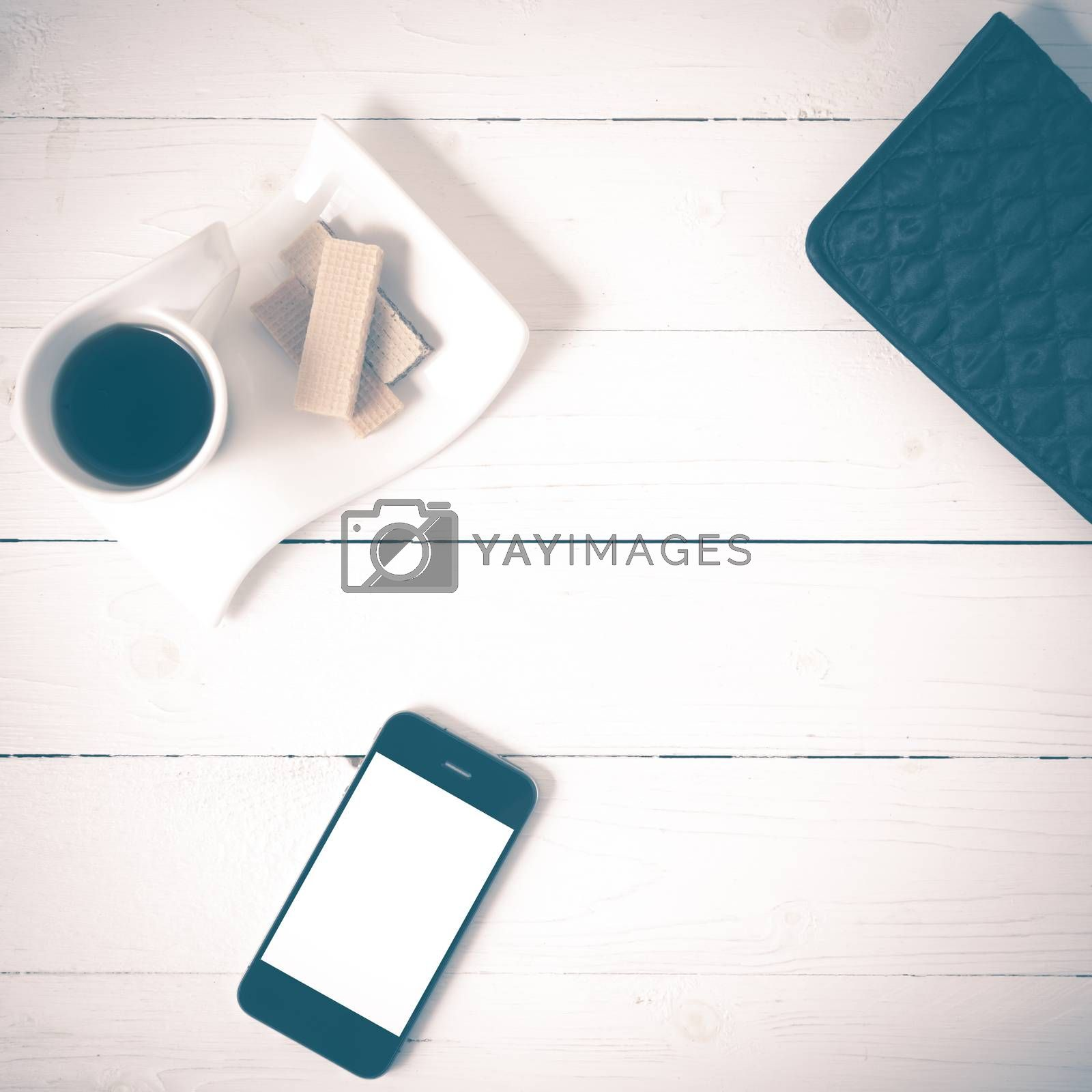 coffee cup with wafer,phone,wallet on white wood background vintage style