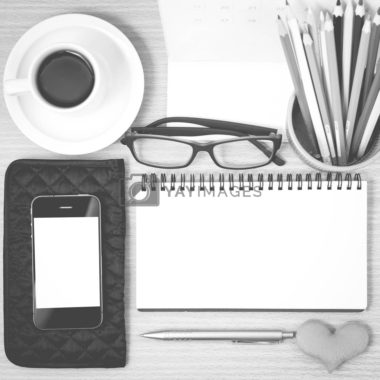 office desk : coffee with phone,wallet,calendar,color pencil box,notepad,heart on wood background black and white color