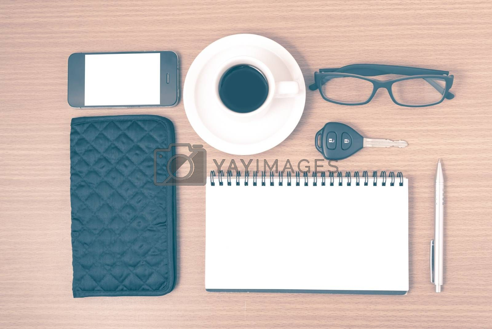 coffee and phone with notepad,car key,eyeglasses and wallet vint by Nisakorn Neera
