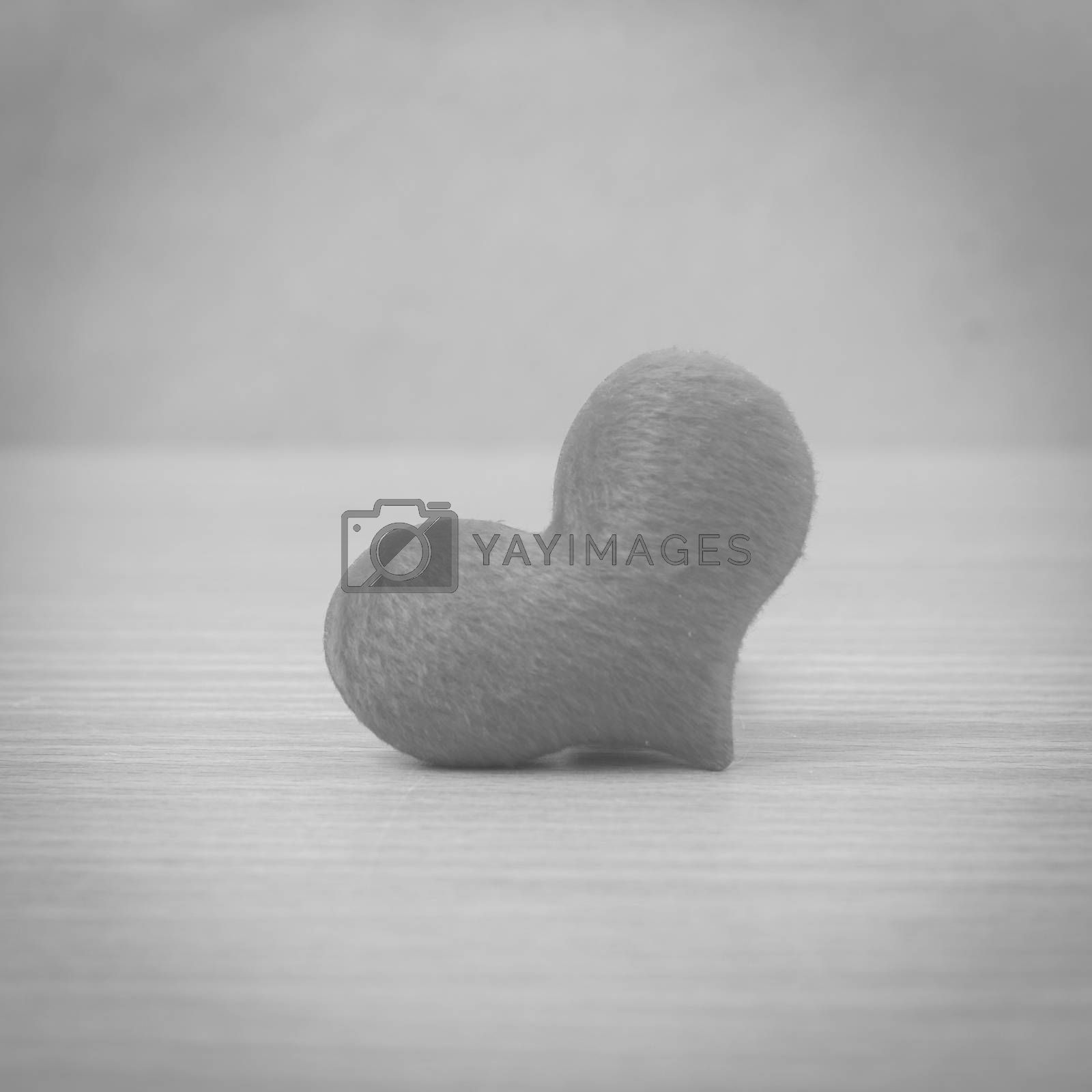 red heart on wood table background black and white color