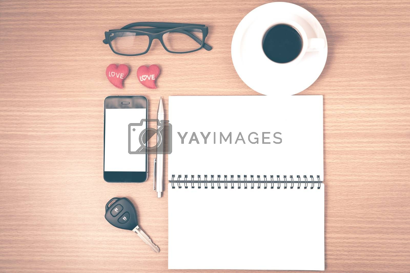 Royalty free image of office desk : coffee and phone with car key,eyeglasses,notepad,h by ammza12
