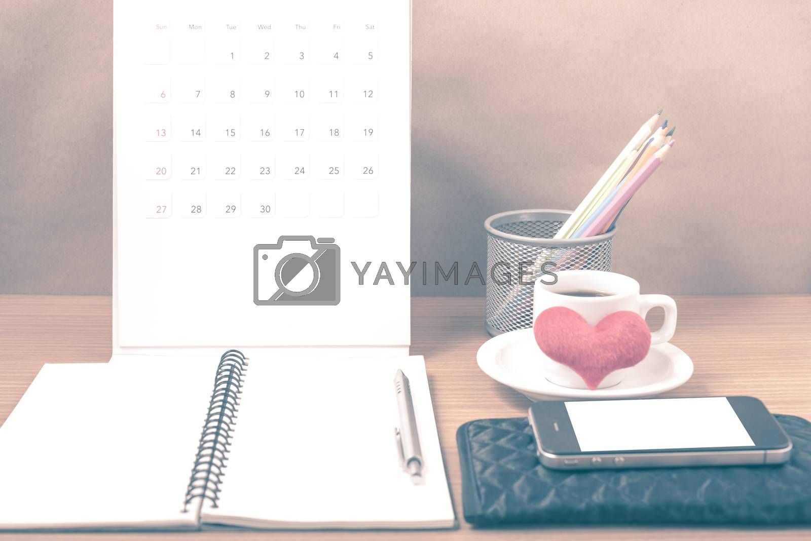 Royalty free image of office desk : coffee with phone,wallet,calendar,heart,color penc by ammza12