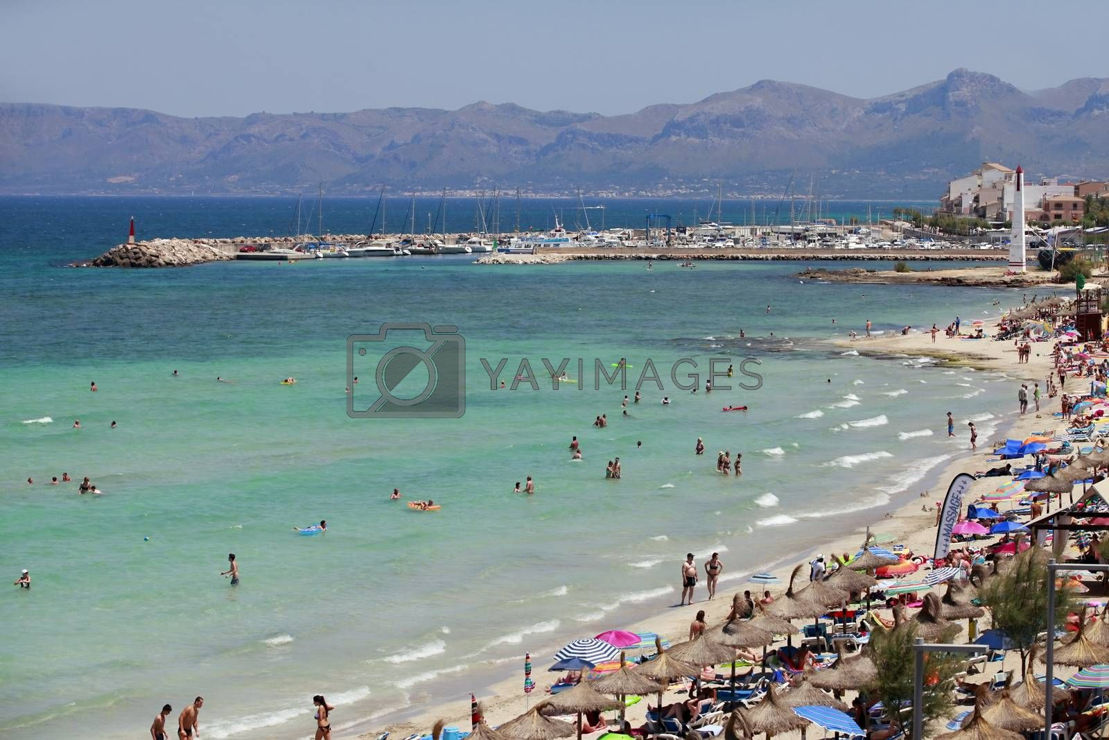 Mallorca, Spain - June 28, 2015: The tourists enjoiying their vacation on the beach. Up to 60 mln tourists is expected to visit Spain in year 2015.