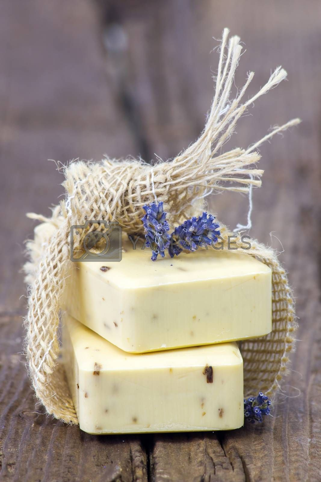 bar of natural soap with dried lavender by miradrozdowski