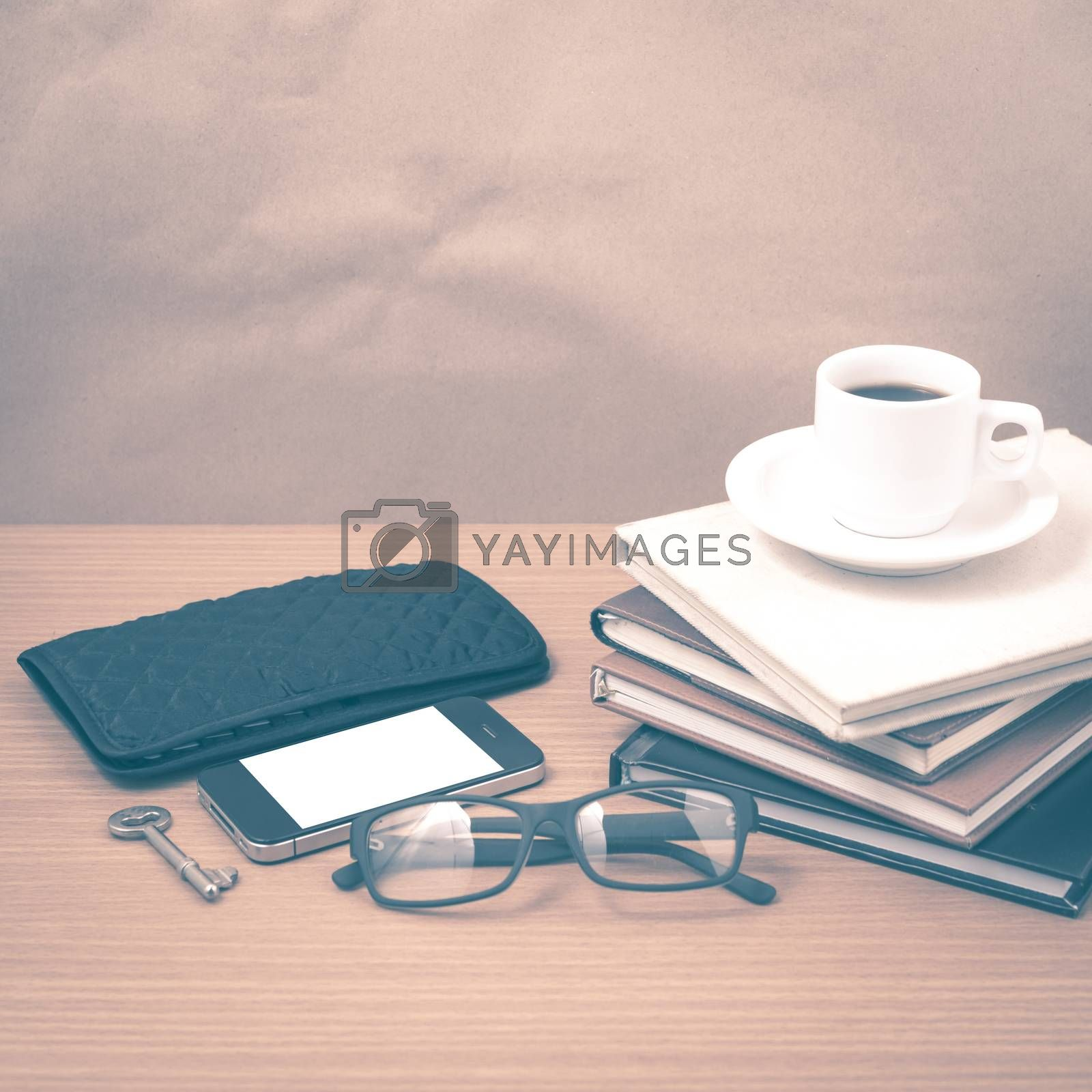 Royalty free image of coffee and phone with stack of book,key,eyeglasses and wallet vi by ammza12
