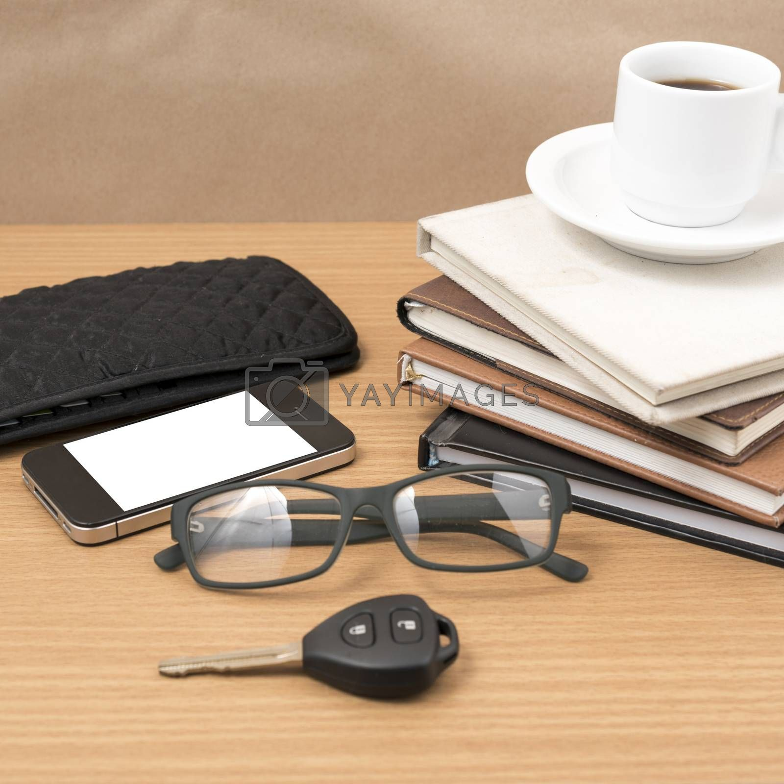 coffee and phone with stack of book,car key,eyeglasses and wallet on wood background