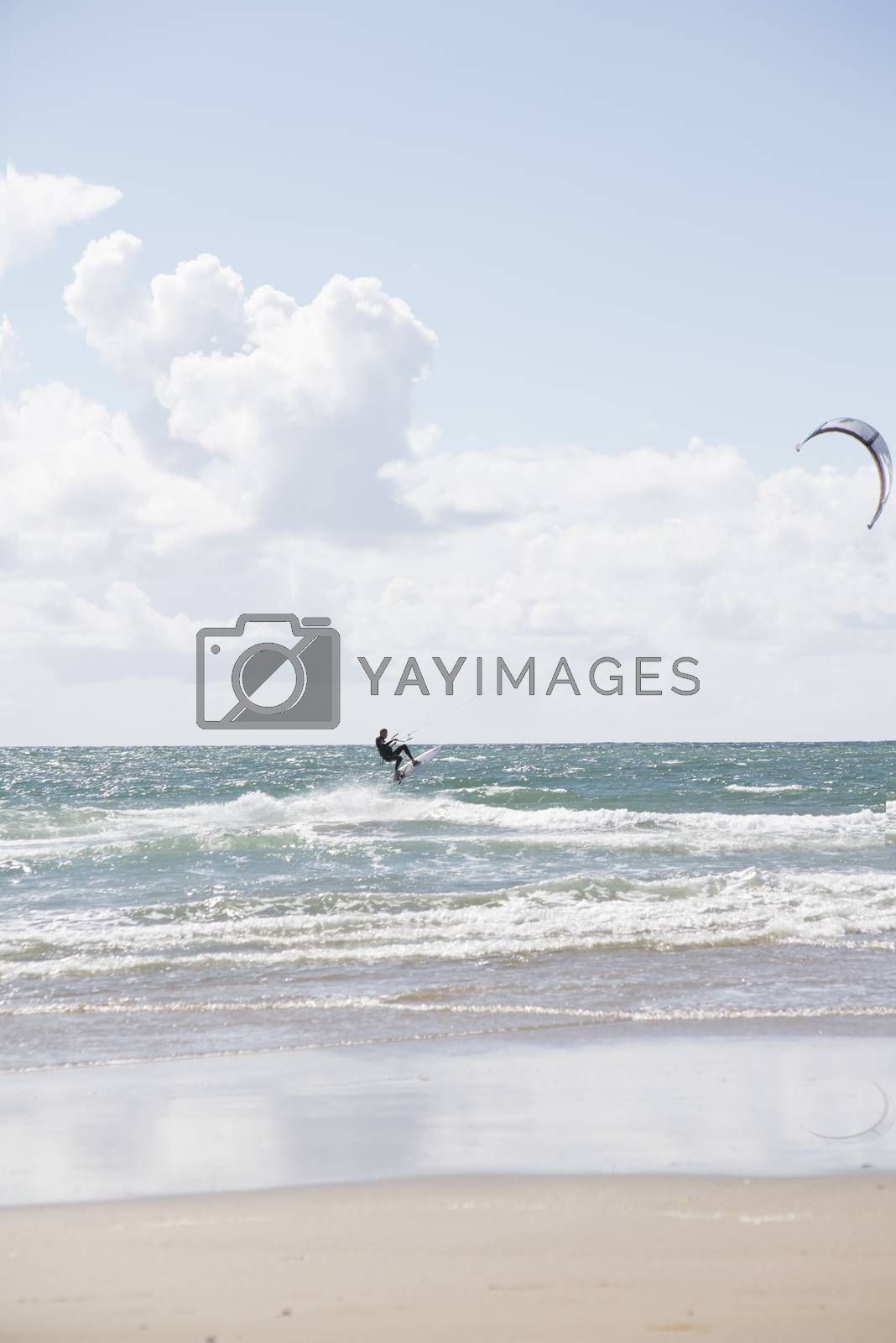 kite surfer on beautiful waves by morrbyte