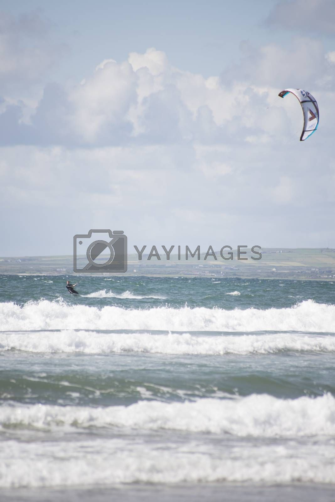 kite surfer on big waves by morrbyte