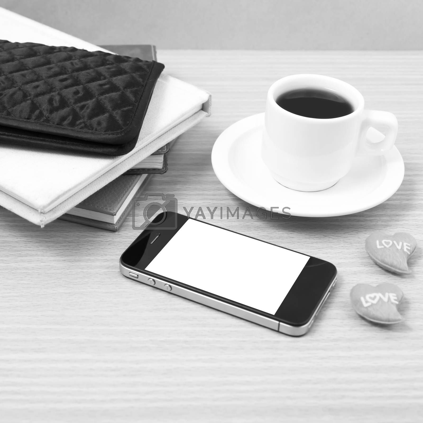 office desk : coffee with phone,heart,stack of book,wallet on wood background black and white color