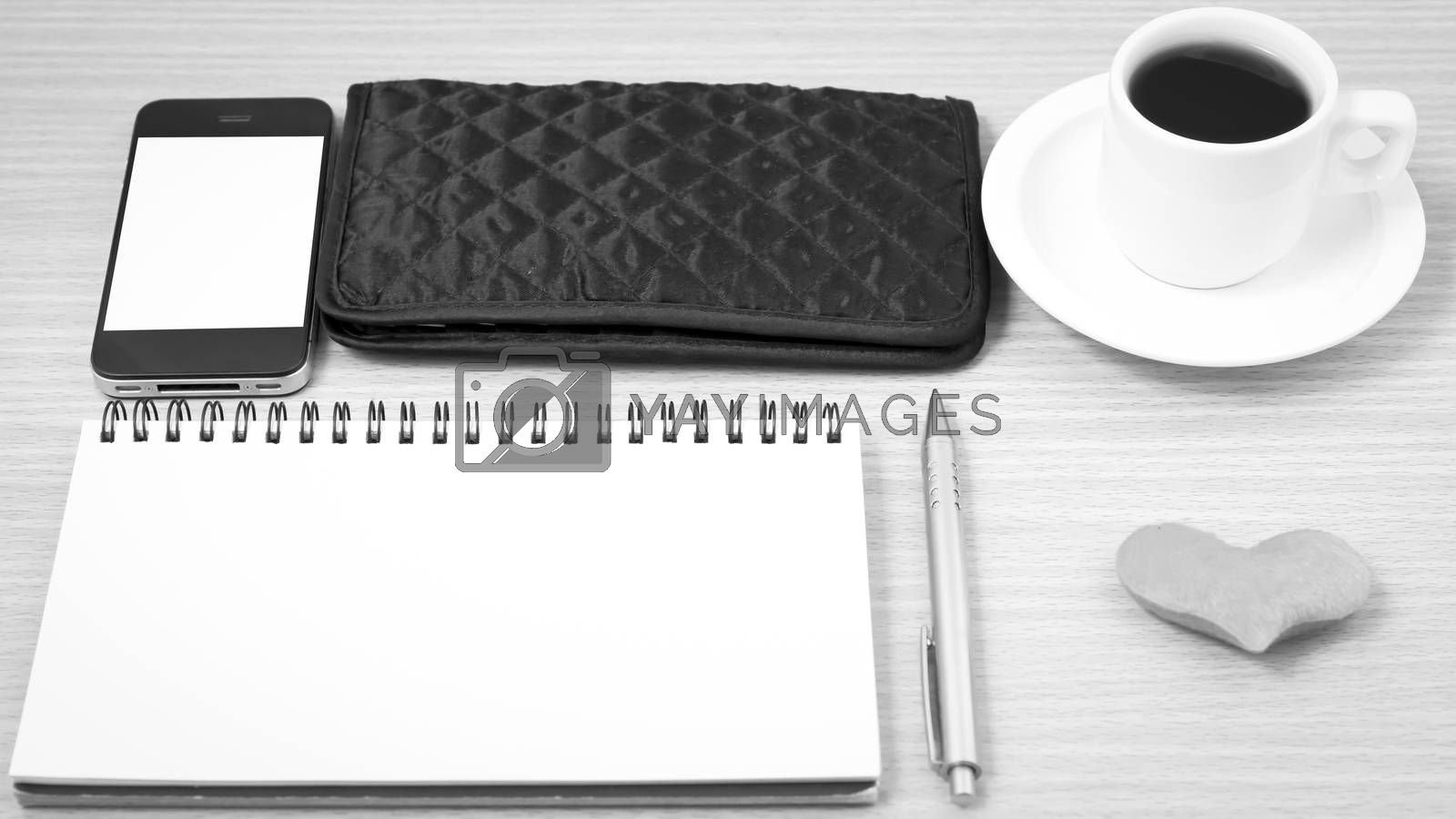 office desk : coffee with phone,heart,notepad,wallet on wood background black and white color