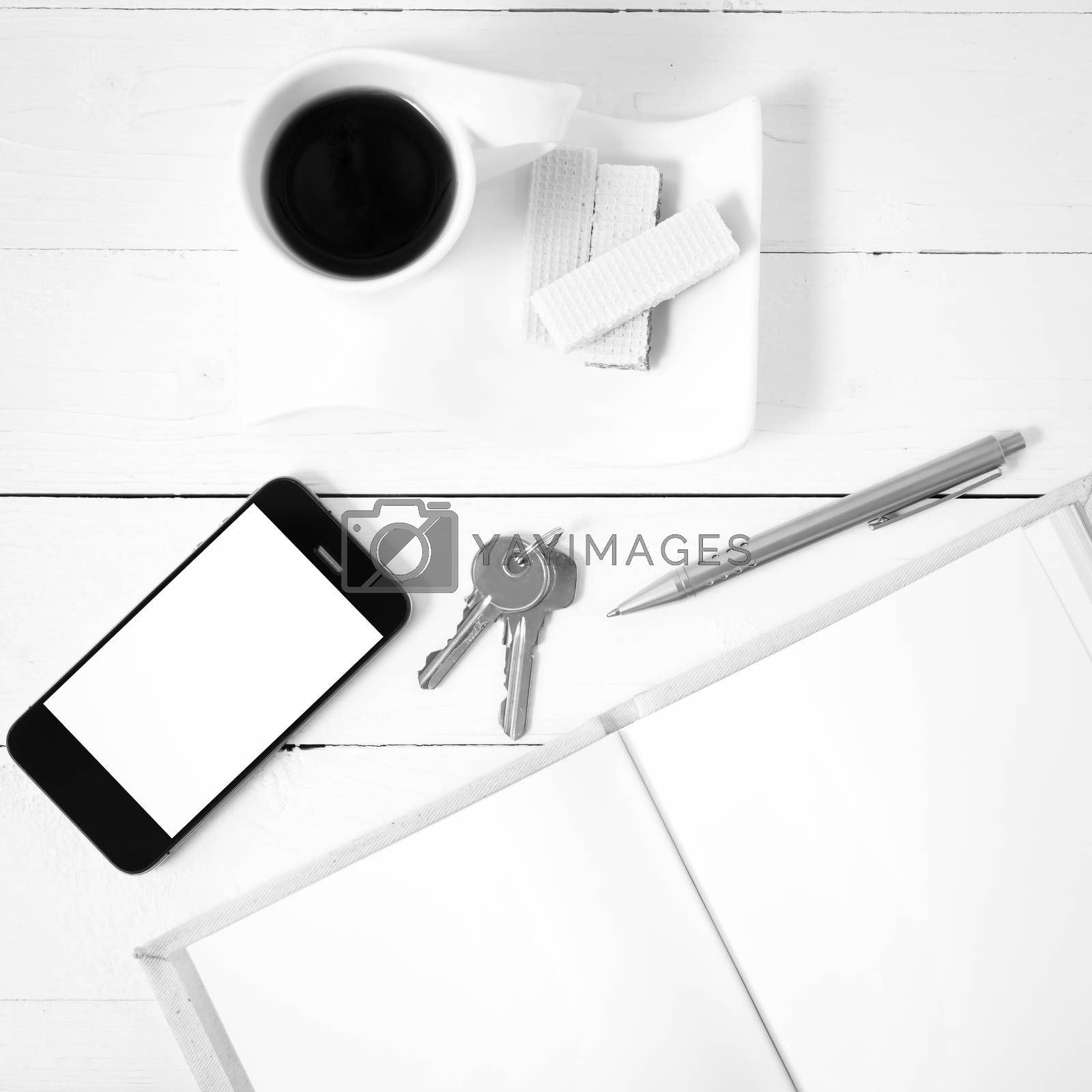 coffee cup with wafer,phone,key,notebook black and white color by Nisakorn Neera