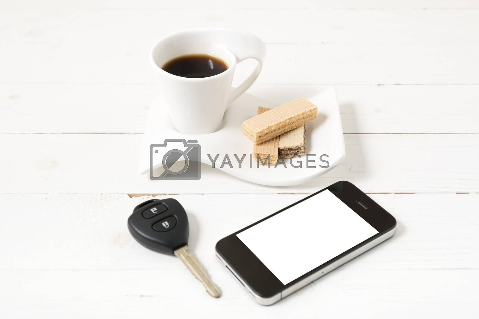 coffee cup with wafer,phone,car key on white wood background