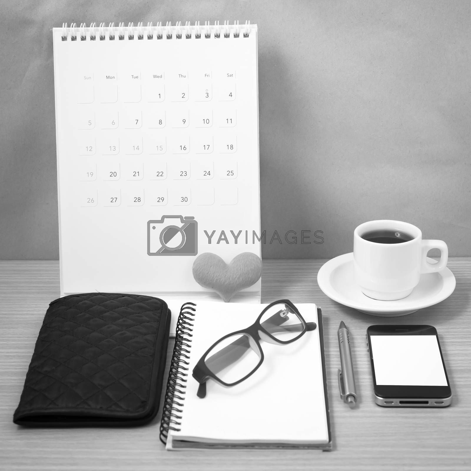 office desk : coffee with phone,wallet,calendar,heart,notepad,eyeglasses,heart on wood background black and white color