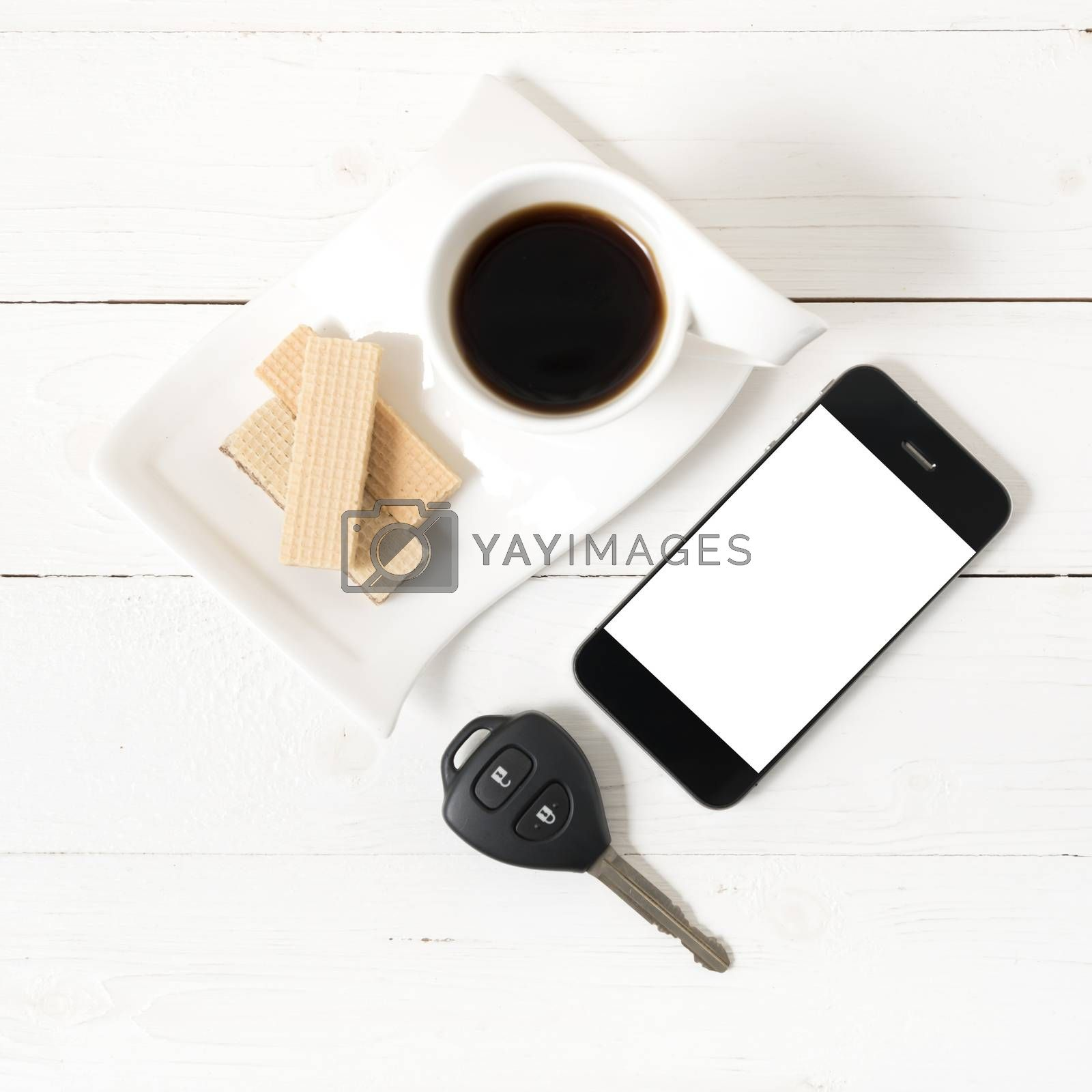 coffee cup with wafer,phone,car key by Nisakorn Neera