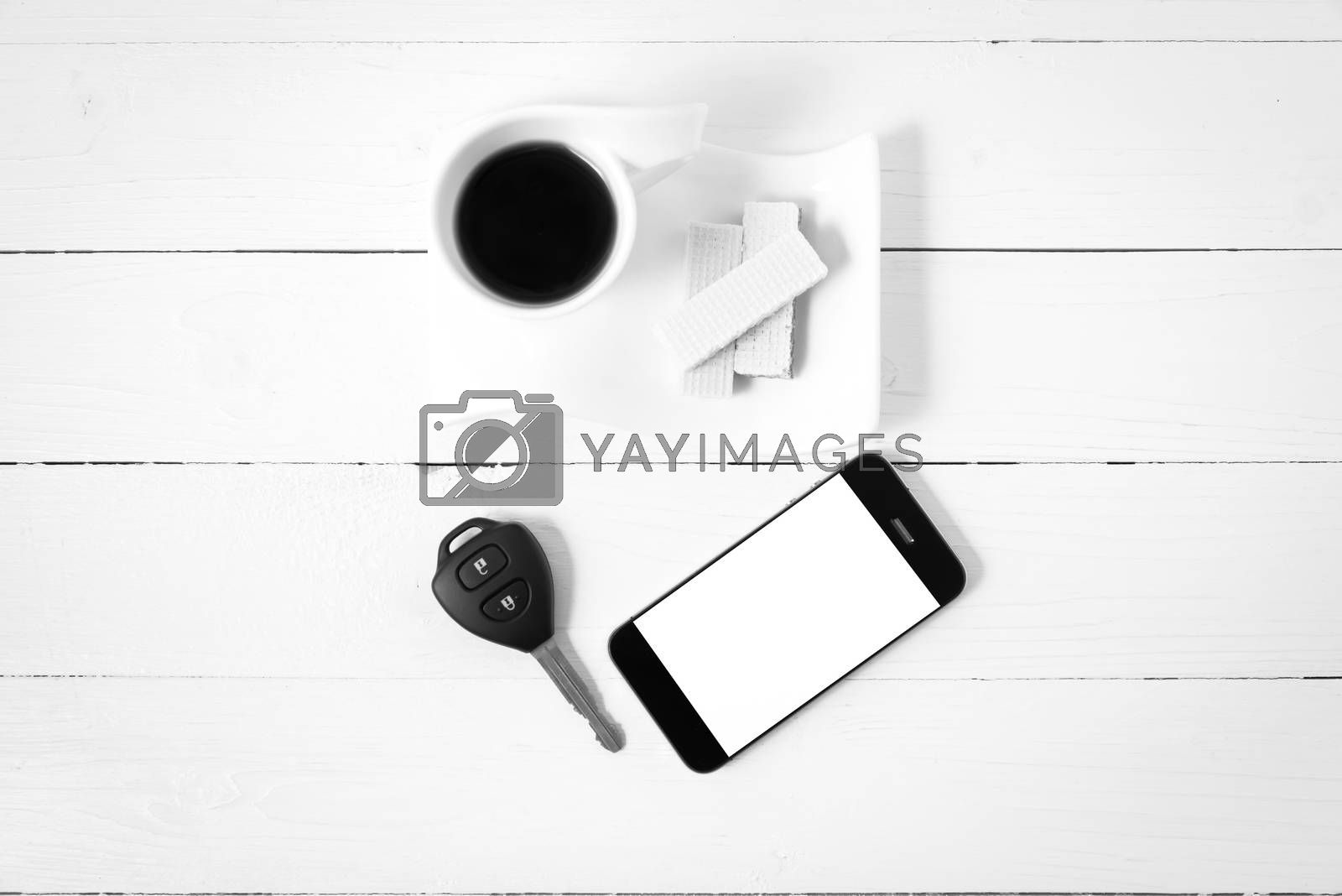coffee cup with wafer,phone,car key black and white color by Nisakorn Neera