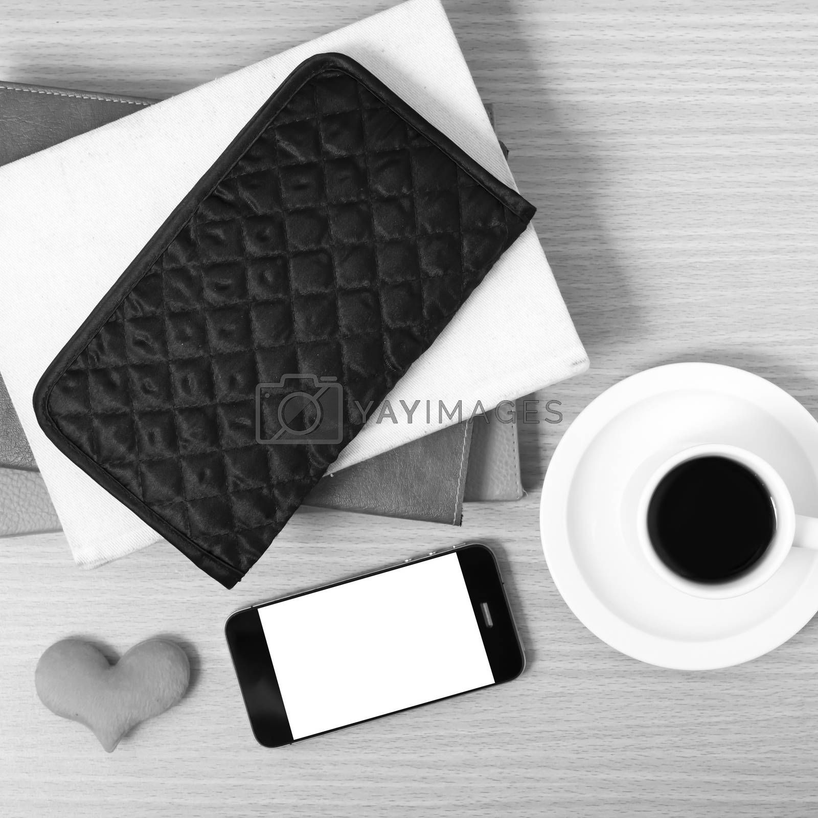 working table : coffee with phone,stack of book,wallet and heart by Nisakorn Neera