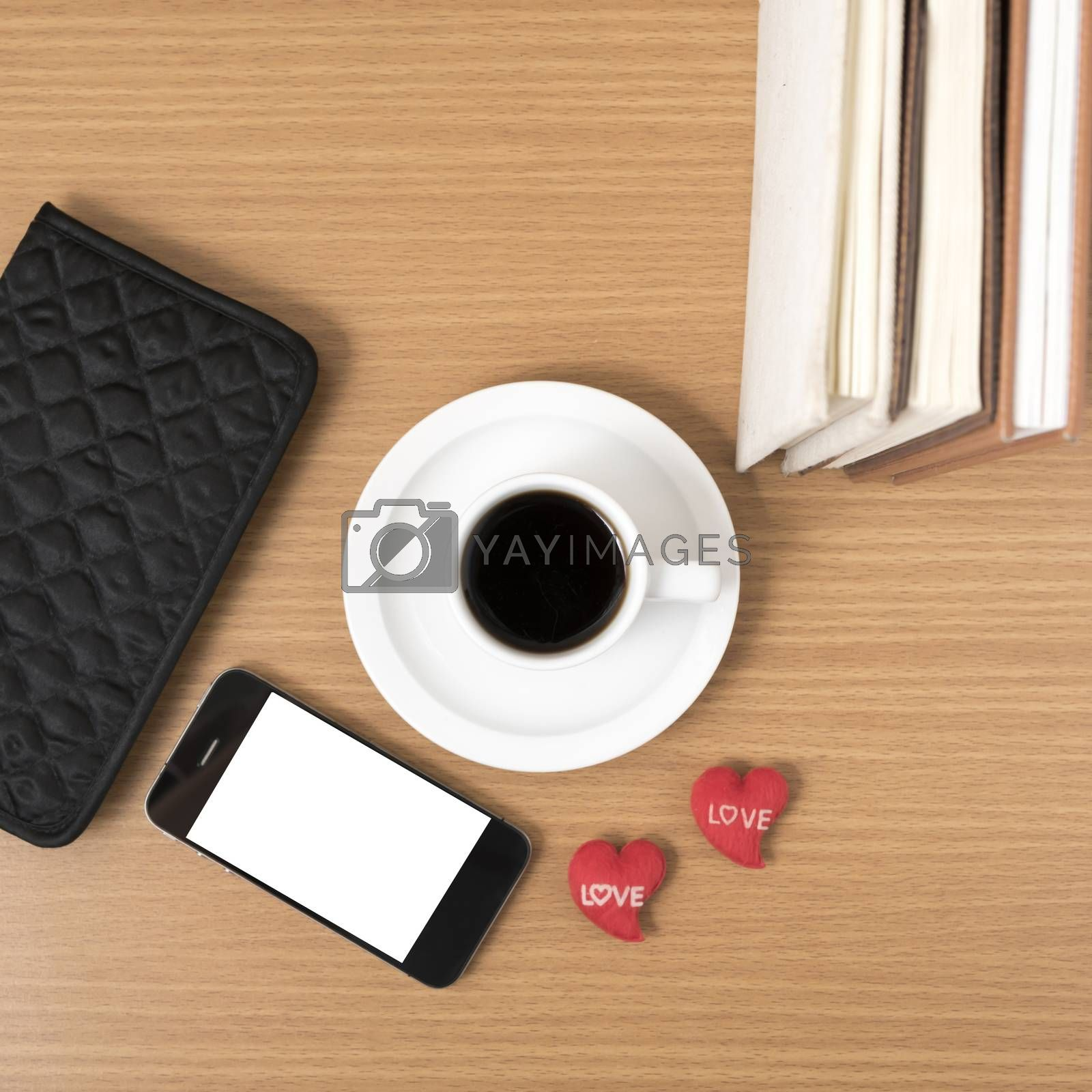 office desk : coffee with phone,heart,stack of book,wallet by Nisakorn Neera